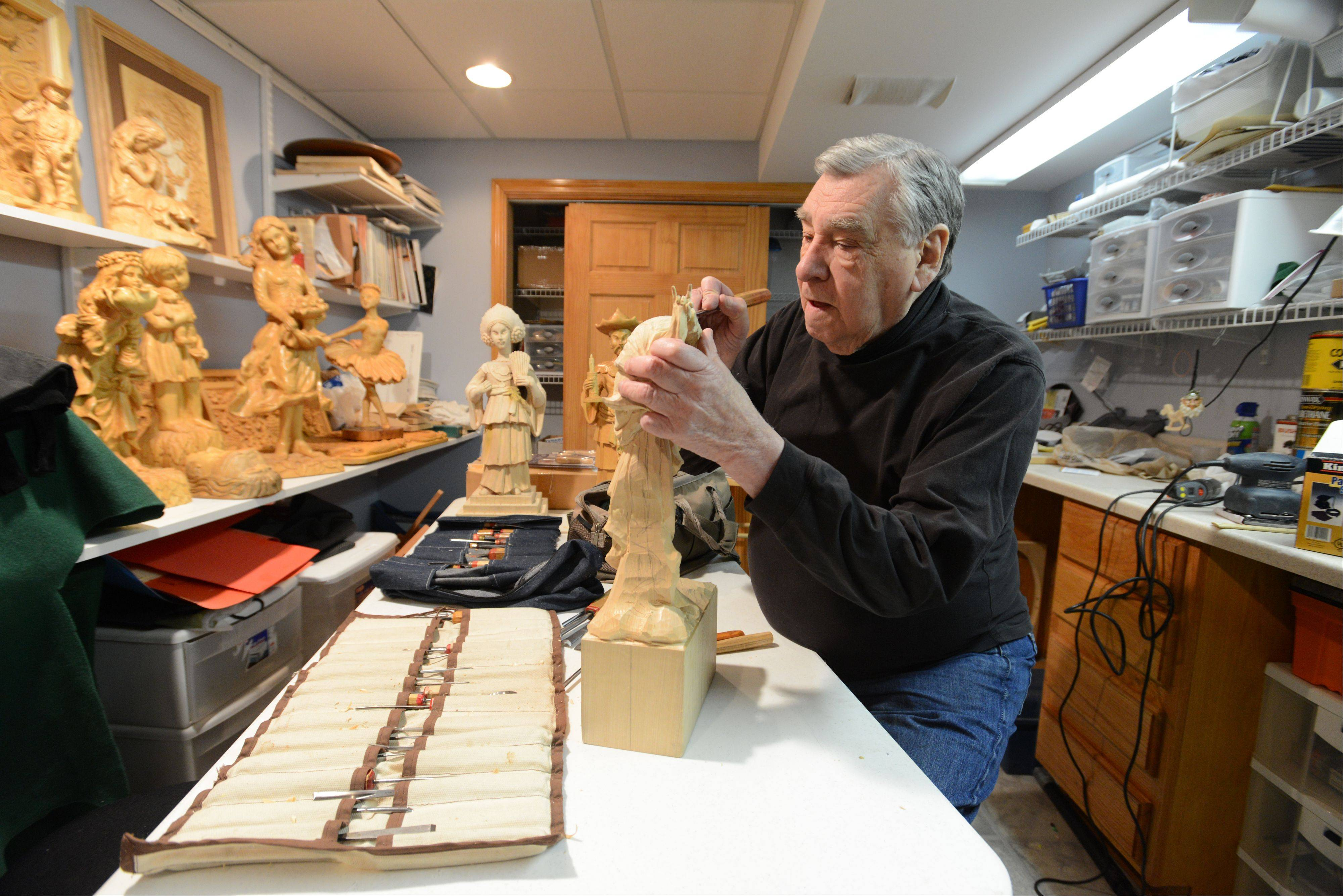 Shelly Weiser, 85, of Naperville has been wood carving for 10 years now. He started after visiting a local wood carving show, and now enjoys carving human and animal figures.