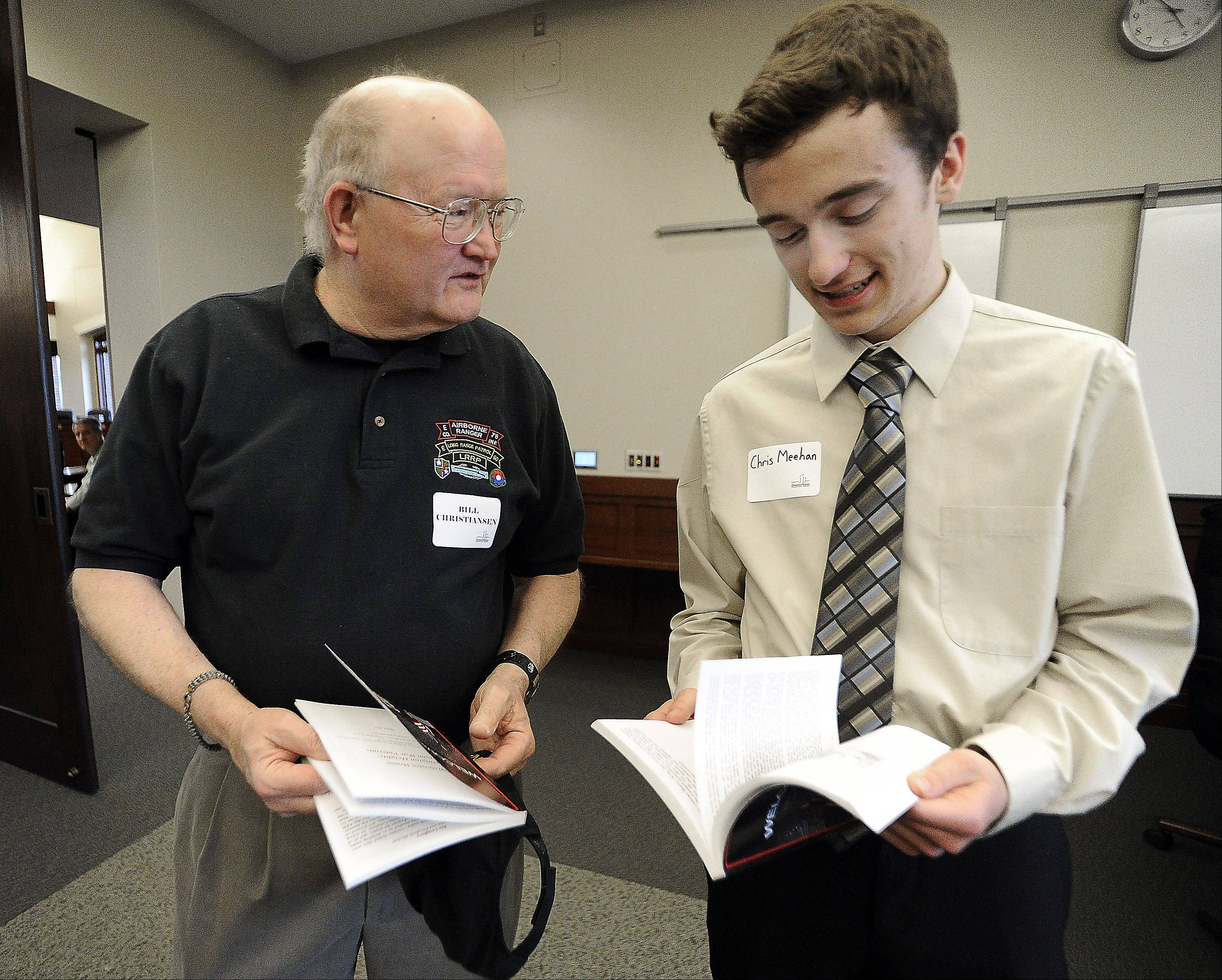 St. Viator junior Chris Meehan talks with veteran Bill Christiansen of Des Plaines, who served in Vietnam in 1969.