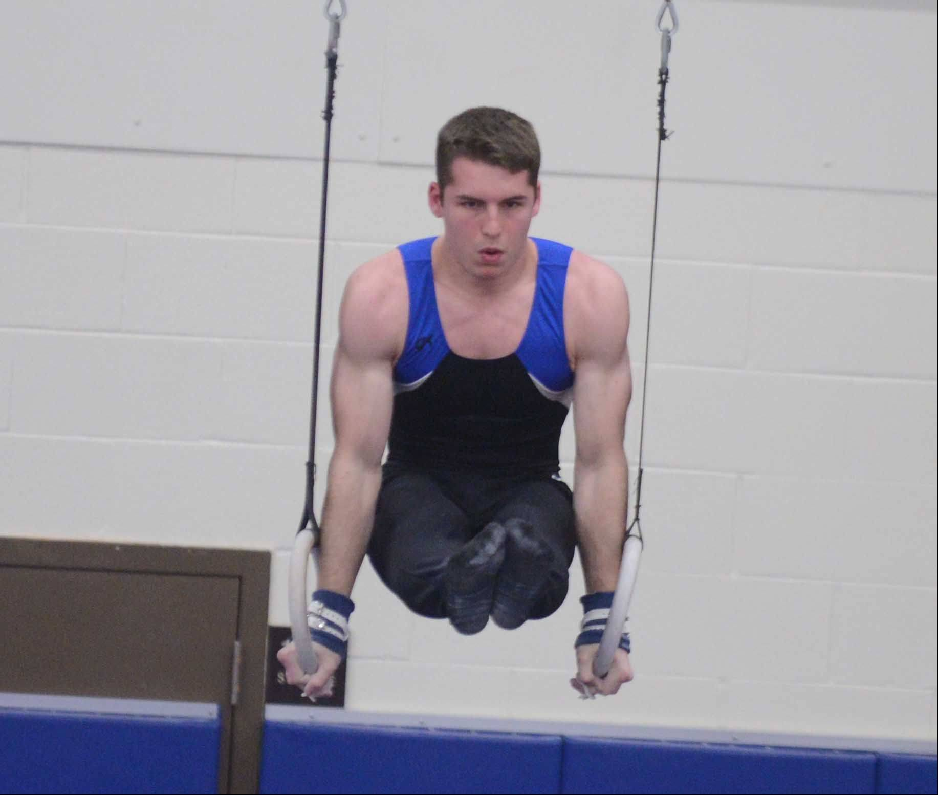 David MacDonald of Wheaton co-op works the still rings on his way to the all-around state championship Friday at Lincoln-Way East in Frankfort.