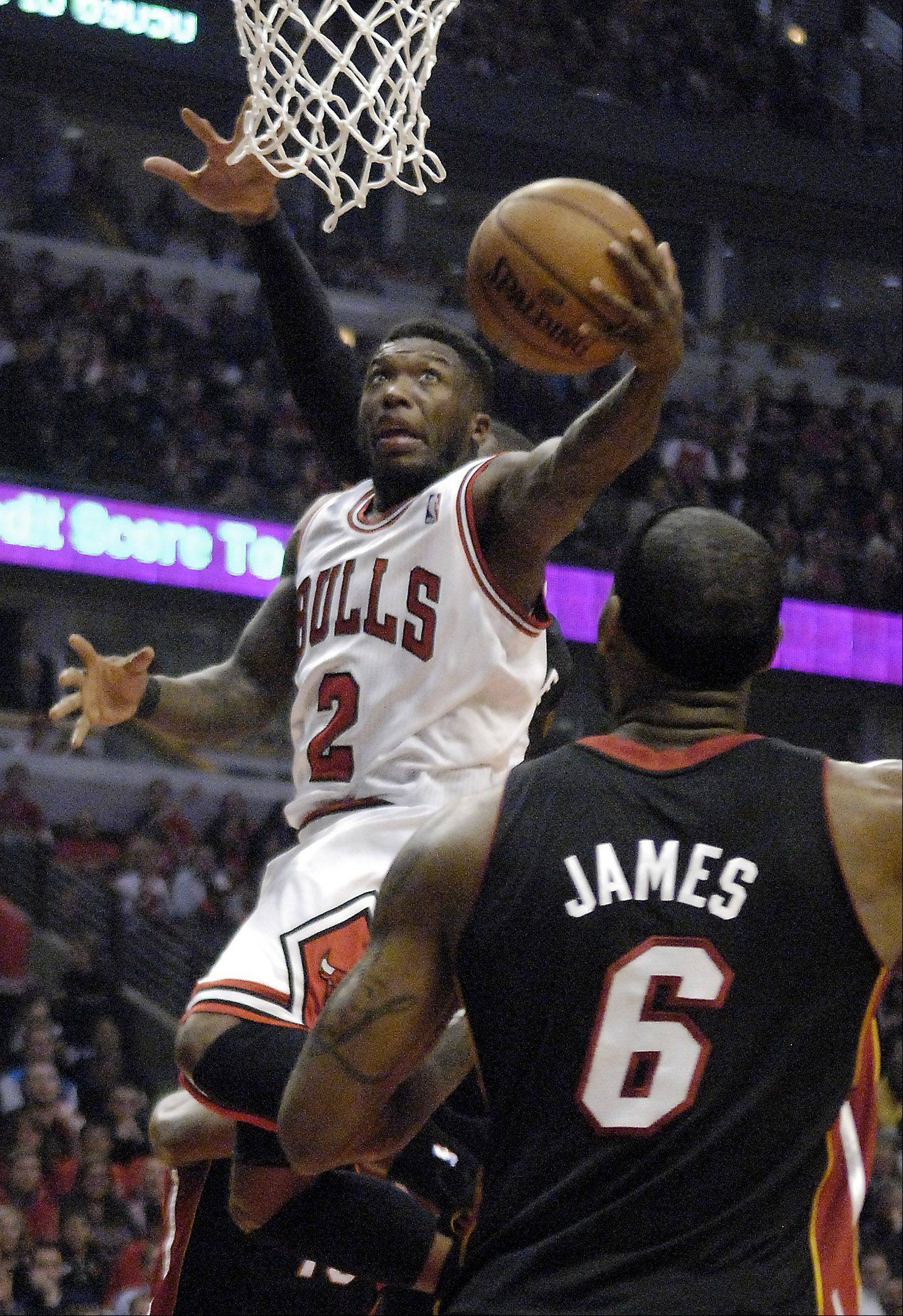 Rick West/rwest@dailyherald.comChicago Bulls point guard Nate Robinson (2) drives to the basket during game 3 of the NBA Eastern Conference semifinals at the United Center in Chicago Friday.