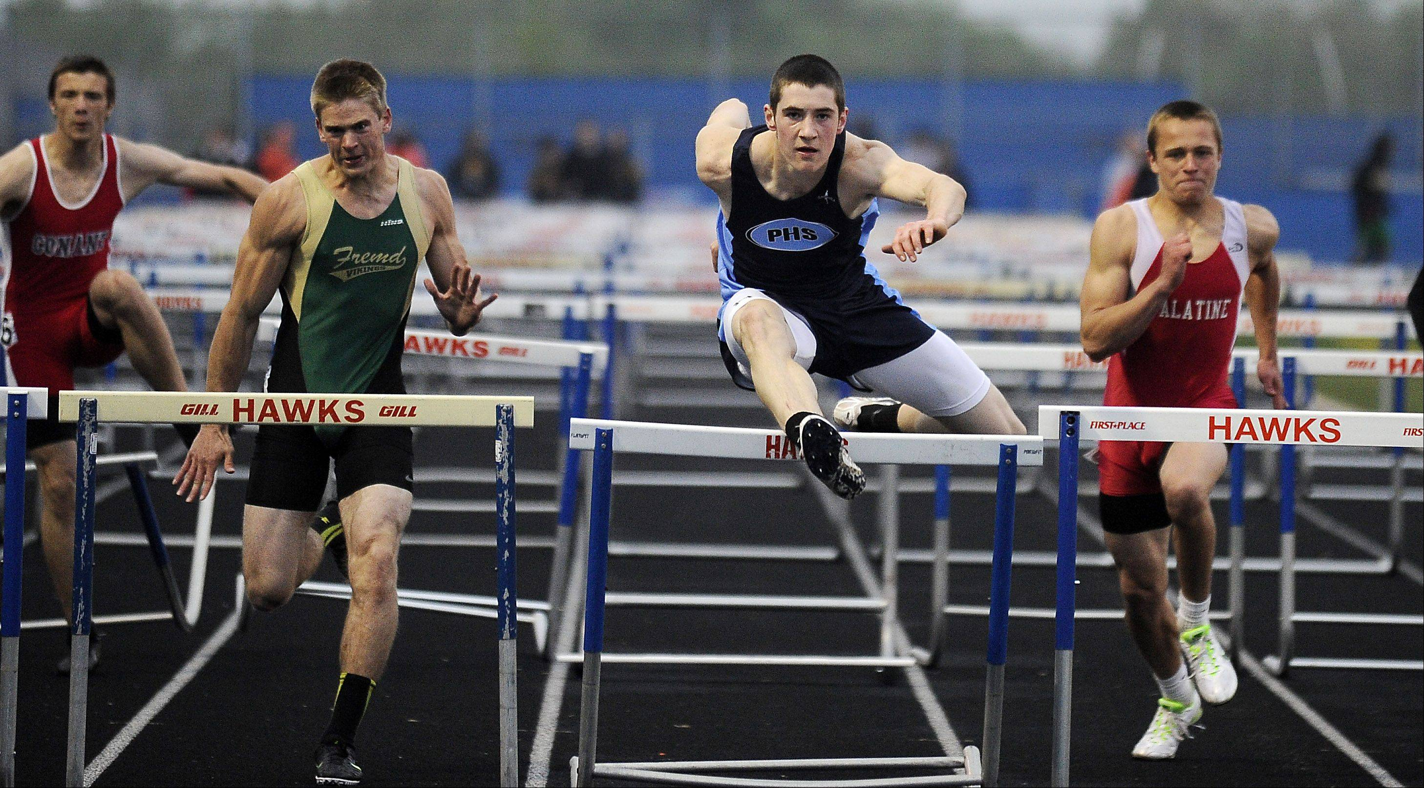 Dave Kendziera of Prospect wins the 110-meter hurdles in the Mid-Suburban League meet at Hoffman Estates on Friday.