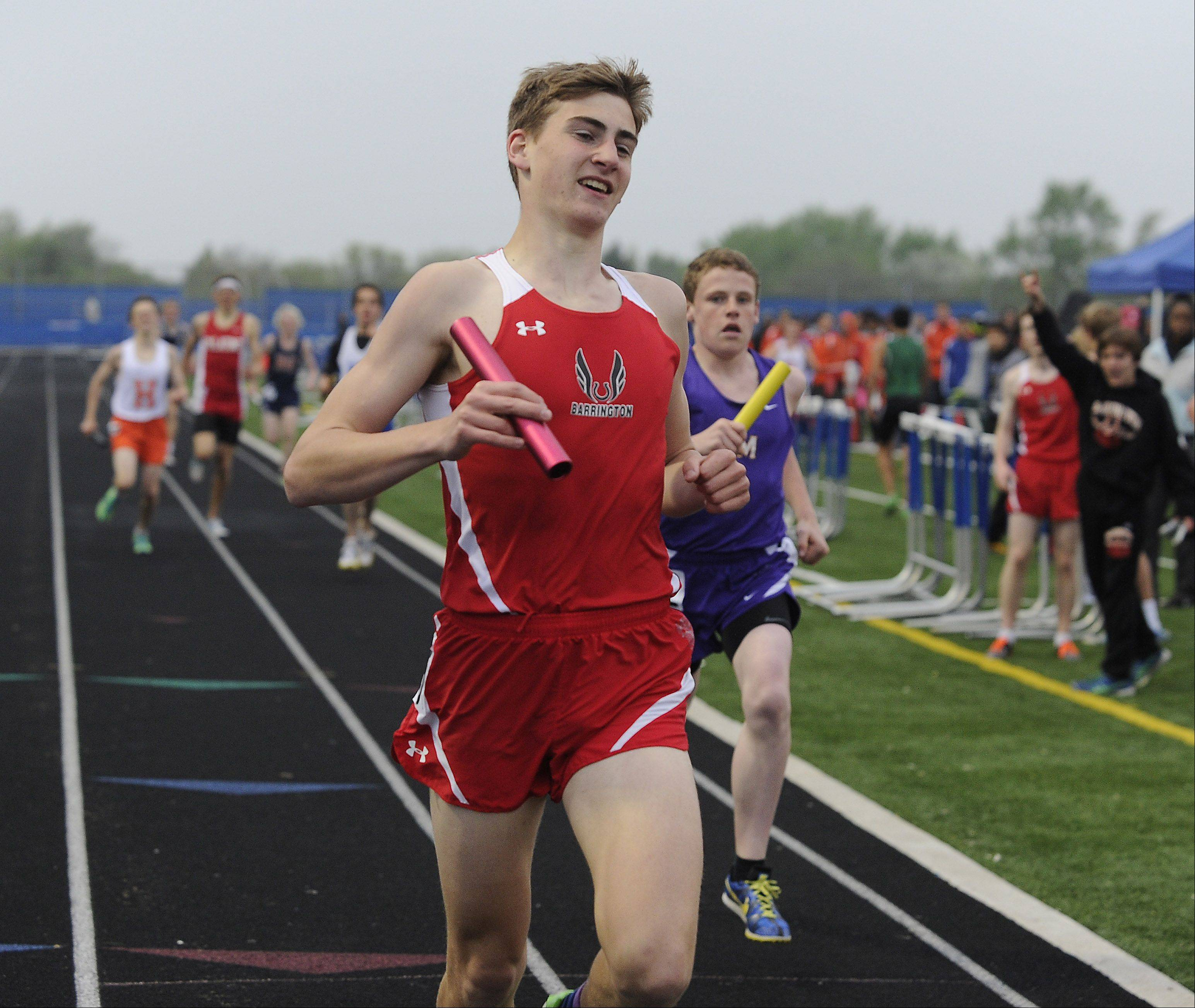 Konrad Eiring of Barrington anchors the winning 4x800-meter relay in the Mid Suburban League meet at Hoffman Estates on Friday.