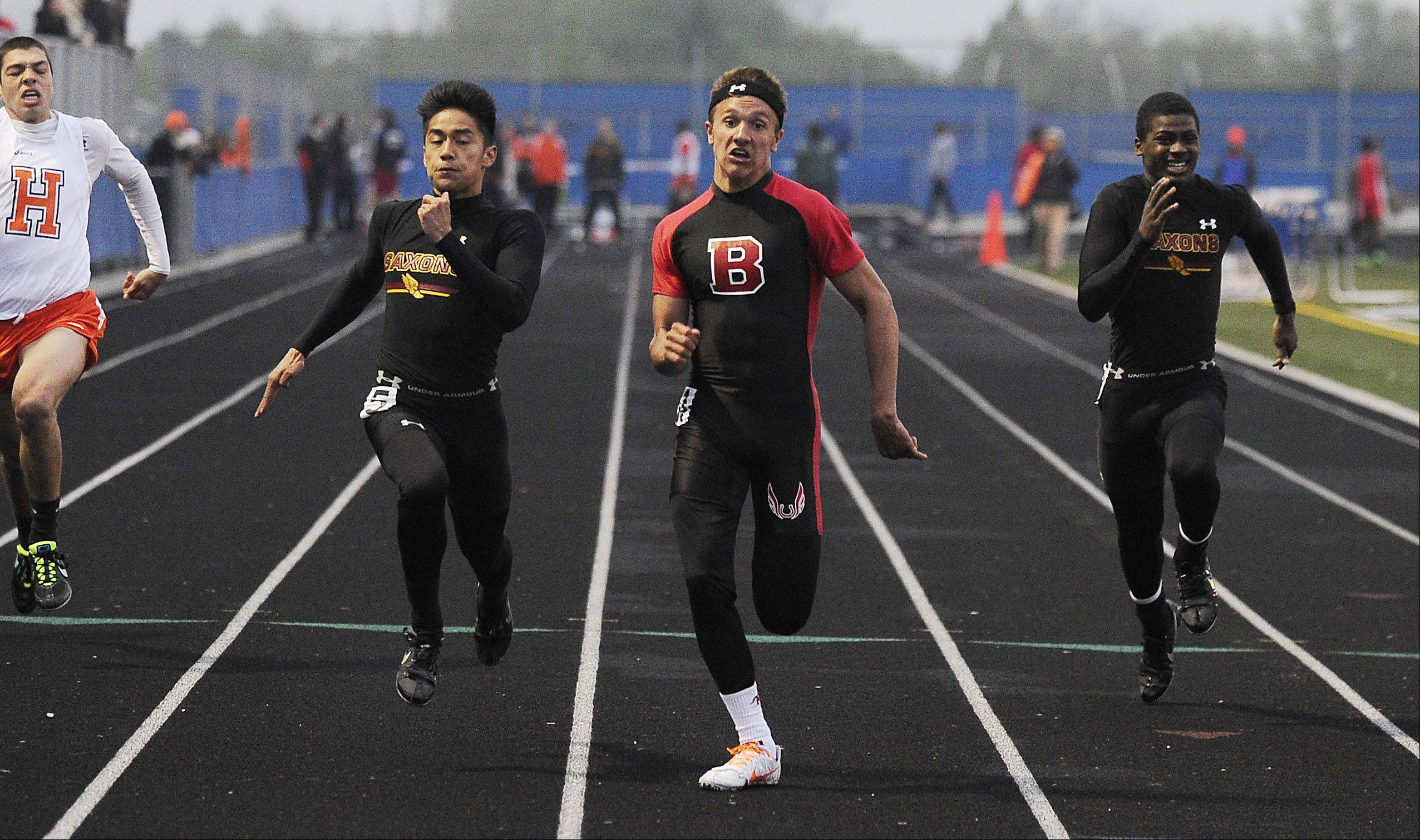 Scott Miller wins the 100-meter dash in the Mid-Suburban League meet at Hoffman Estates on Friday.
