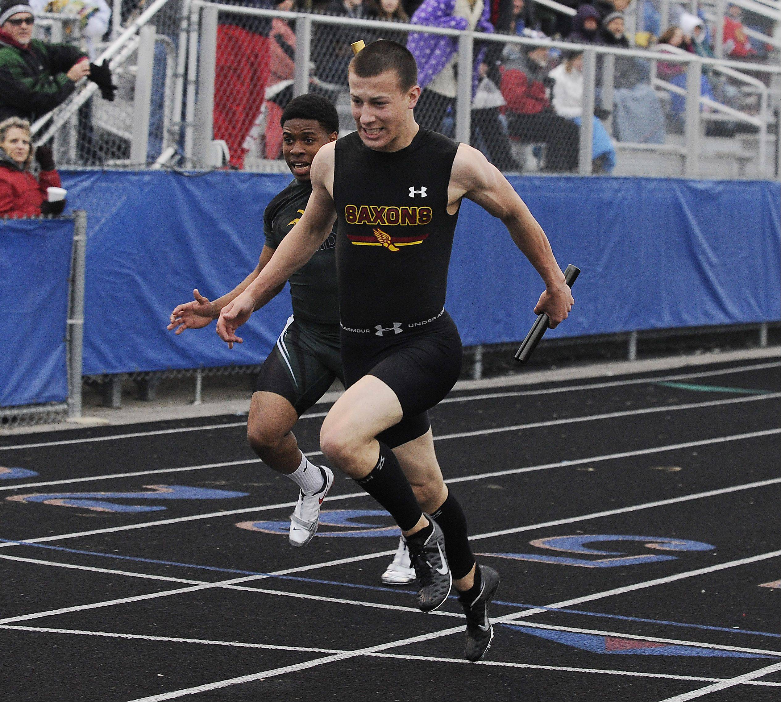 Mark Welsh/mwelsh@dailyherald.comTom Ciupka of Schaumburg takes the anchor leg of the winning 4x100-meter relay in the Mid-Suburban League meet at Hoffman Estates on Friday.