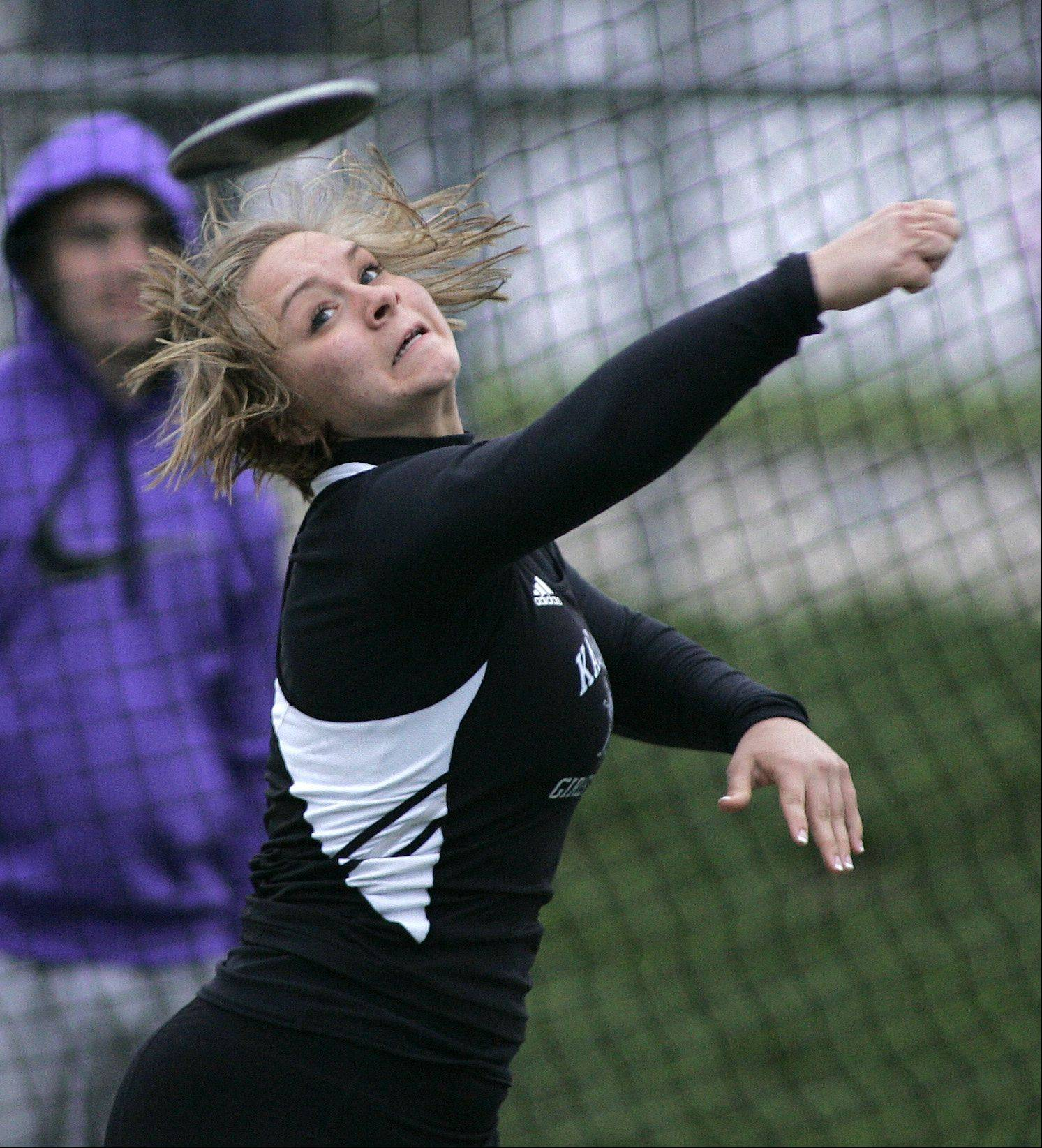 Kaneland's Elle Tattoni competes in the discus during the Burlington Central girls track sectional Friday.