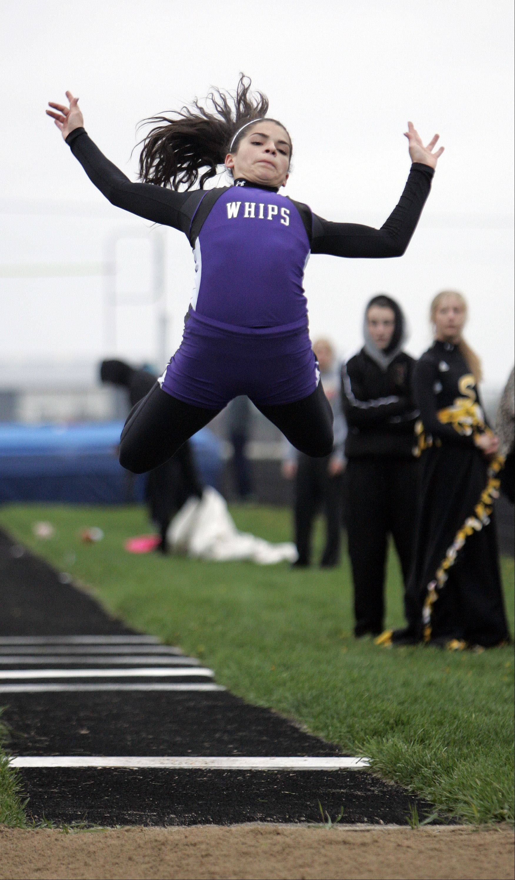 Hampshire's Elizabeth Pagan competes in the long jump during the Burlington Central girls track sectional Friday.