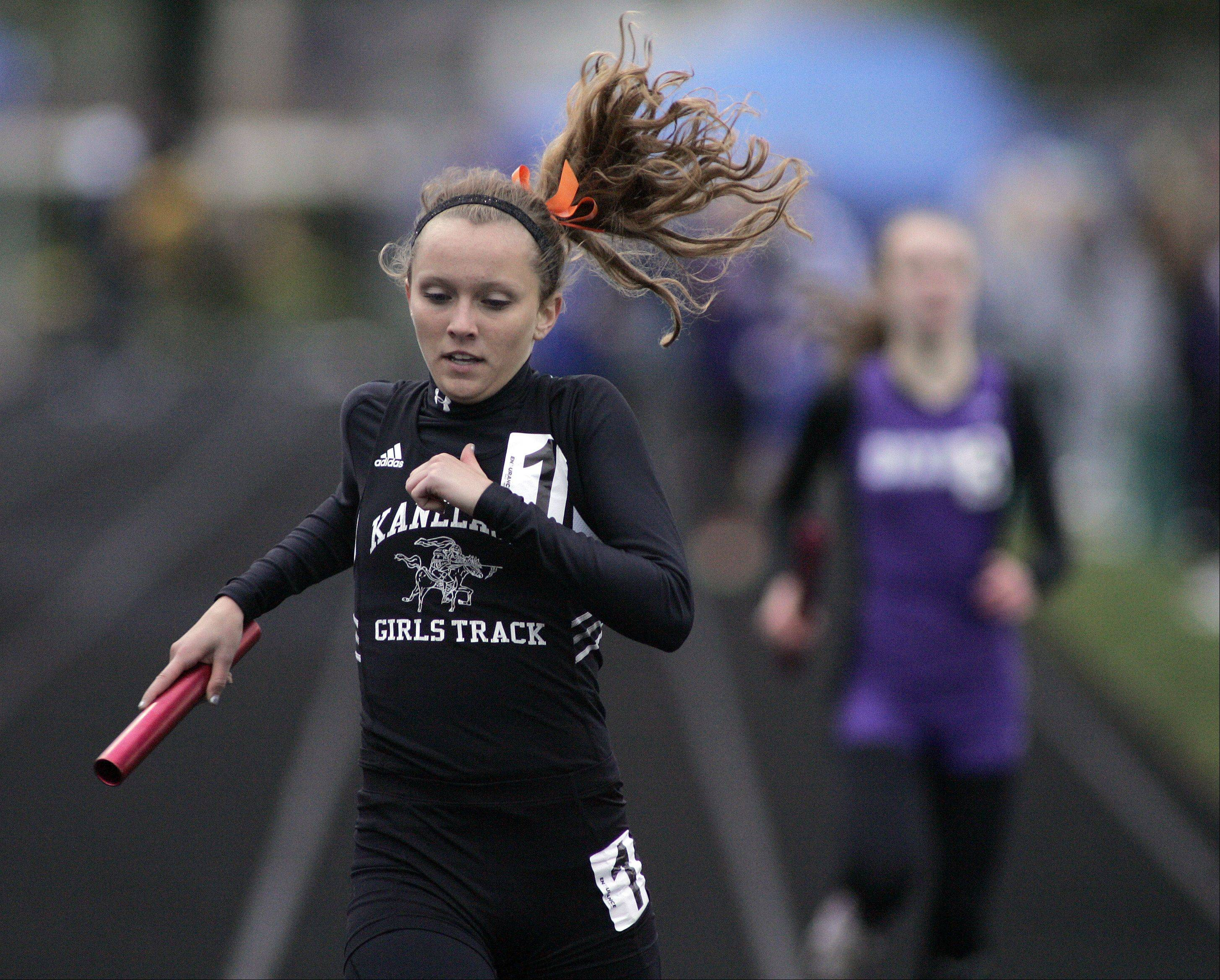 Kaneland competes in the 4x800 meter relay during the Burlington Central girls track sectional Friday.