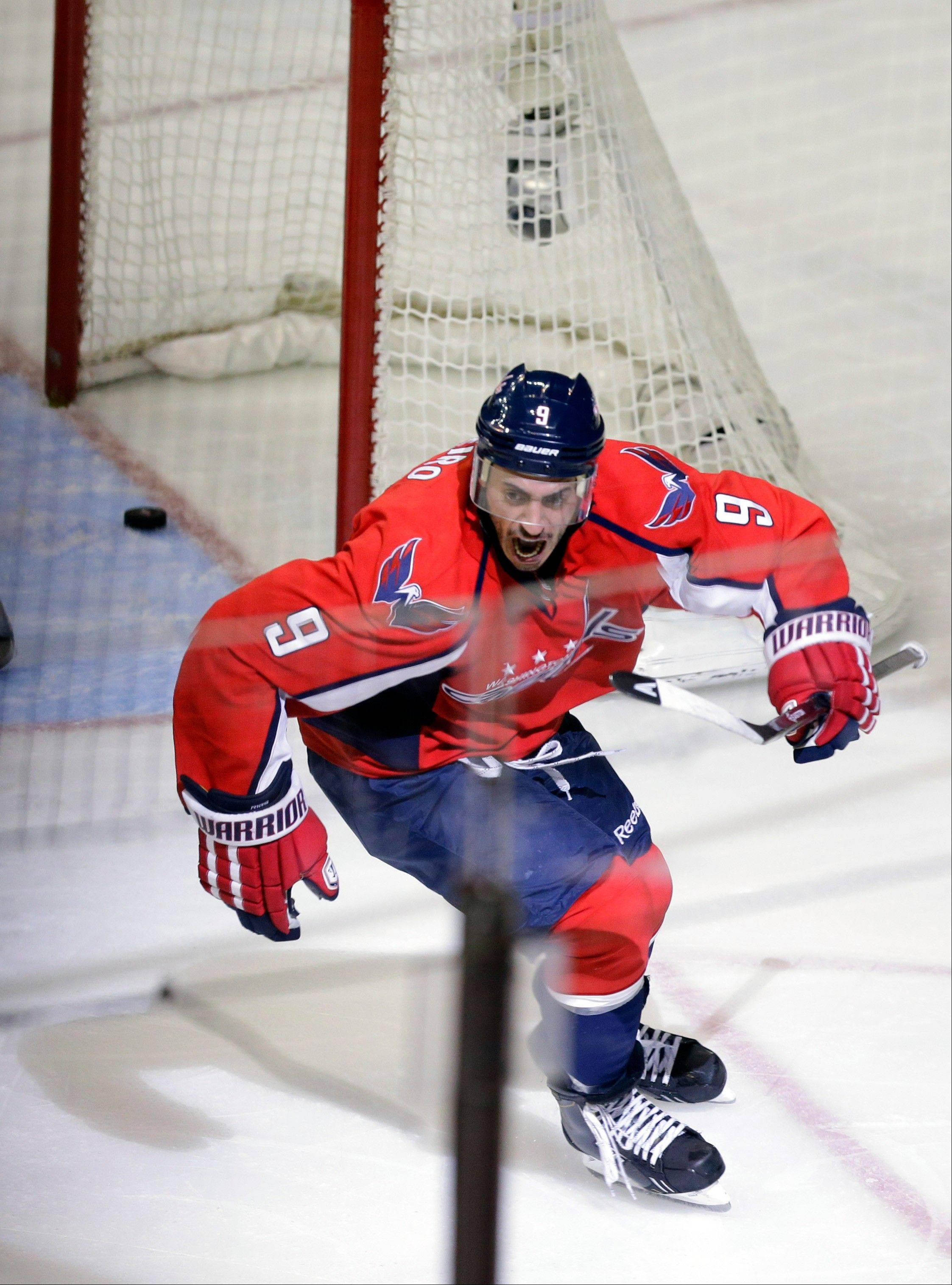 The Washington Capitals center Mike Ribeiro celebrates his game-winning goal in overtime of Game 5 first-round NHL Stanley Cup playoff hockey series against the New York Rangers, Friday, May 10, 2013, in Washington. The Capitals won 2-1, in overtime.