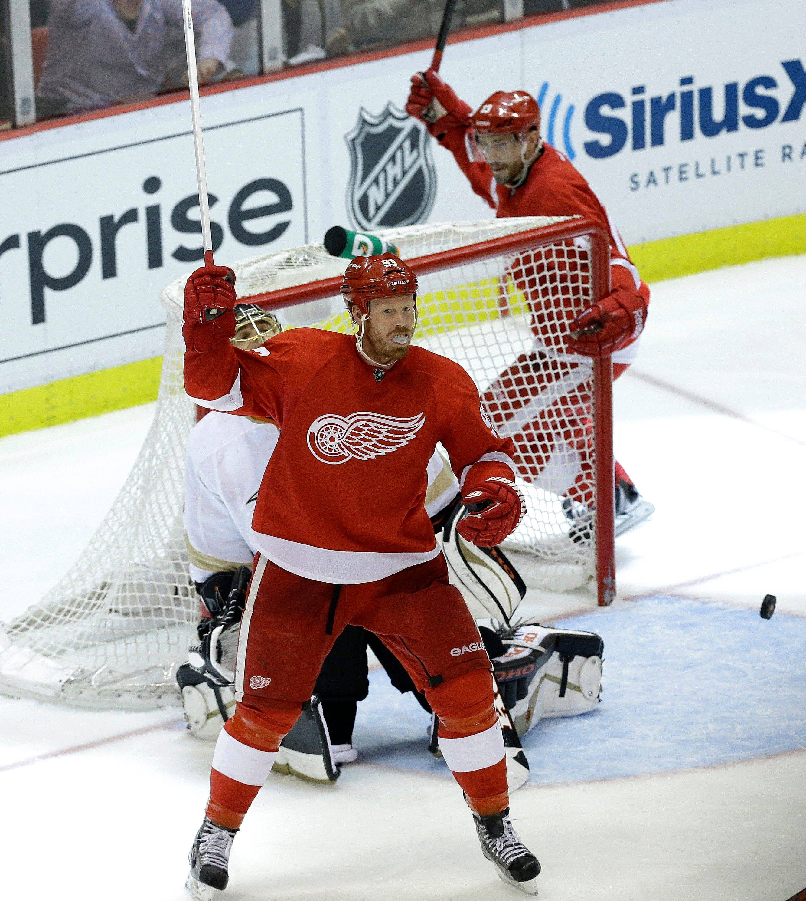Detroit Red Wings left wing Johan Franzen, left, of Sweden, and Pavel Datsyuk right, of Russia, celebrate Detroit Red Wings center Henrik Zetterberg's goal against the Anaheim Ducks in the third period in Game 6 of a first-round NHL hockey Stanley Cup playoff series in Detroit, Friday, May 10, 2013.