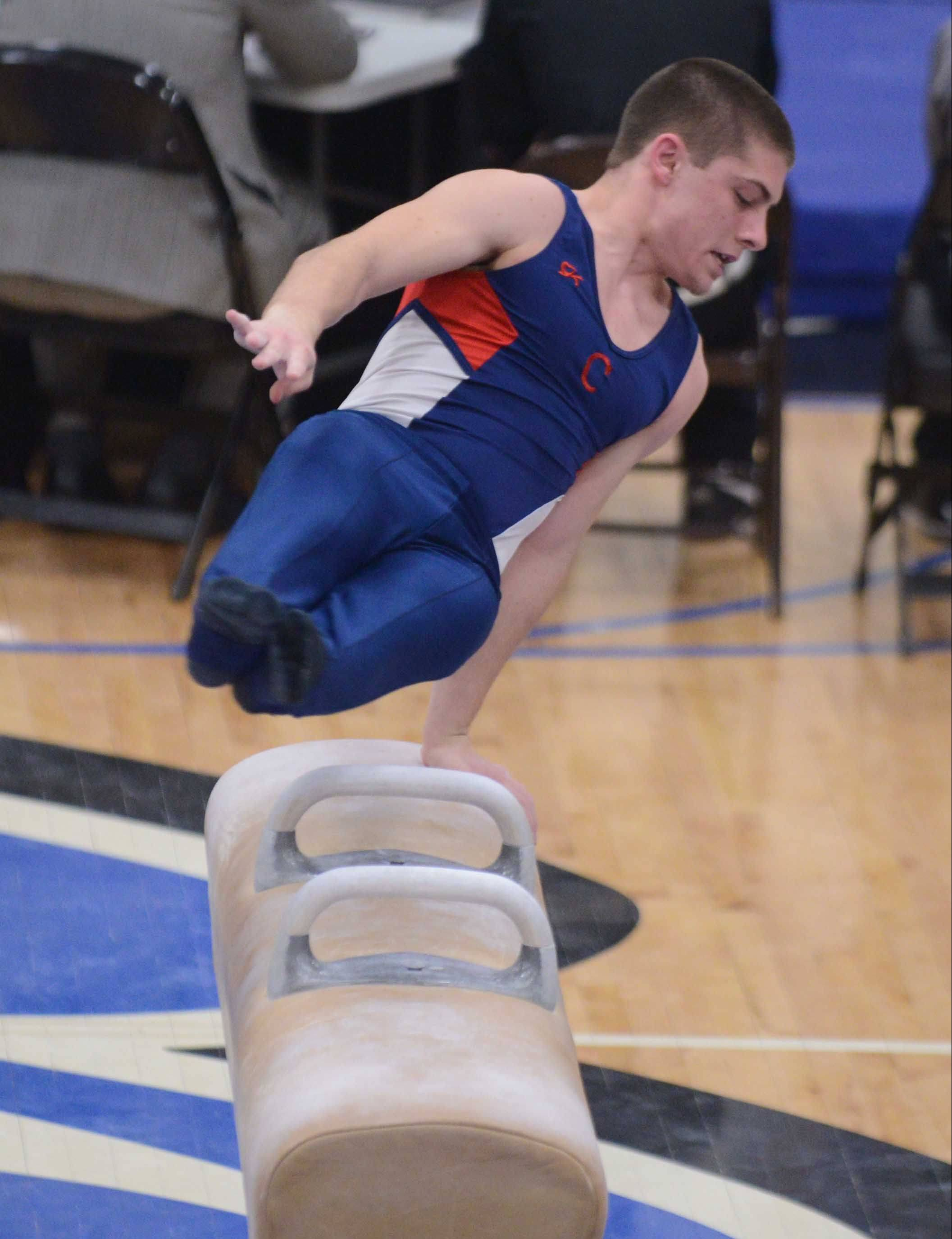 Joey Mauk of Conant works pommel horse during Friday's boys gymnastics state meet action at Lincoln-Way East in Frankfort on Friday.
