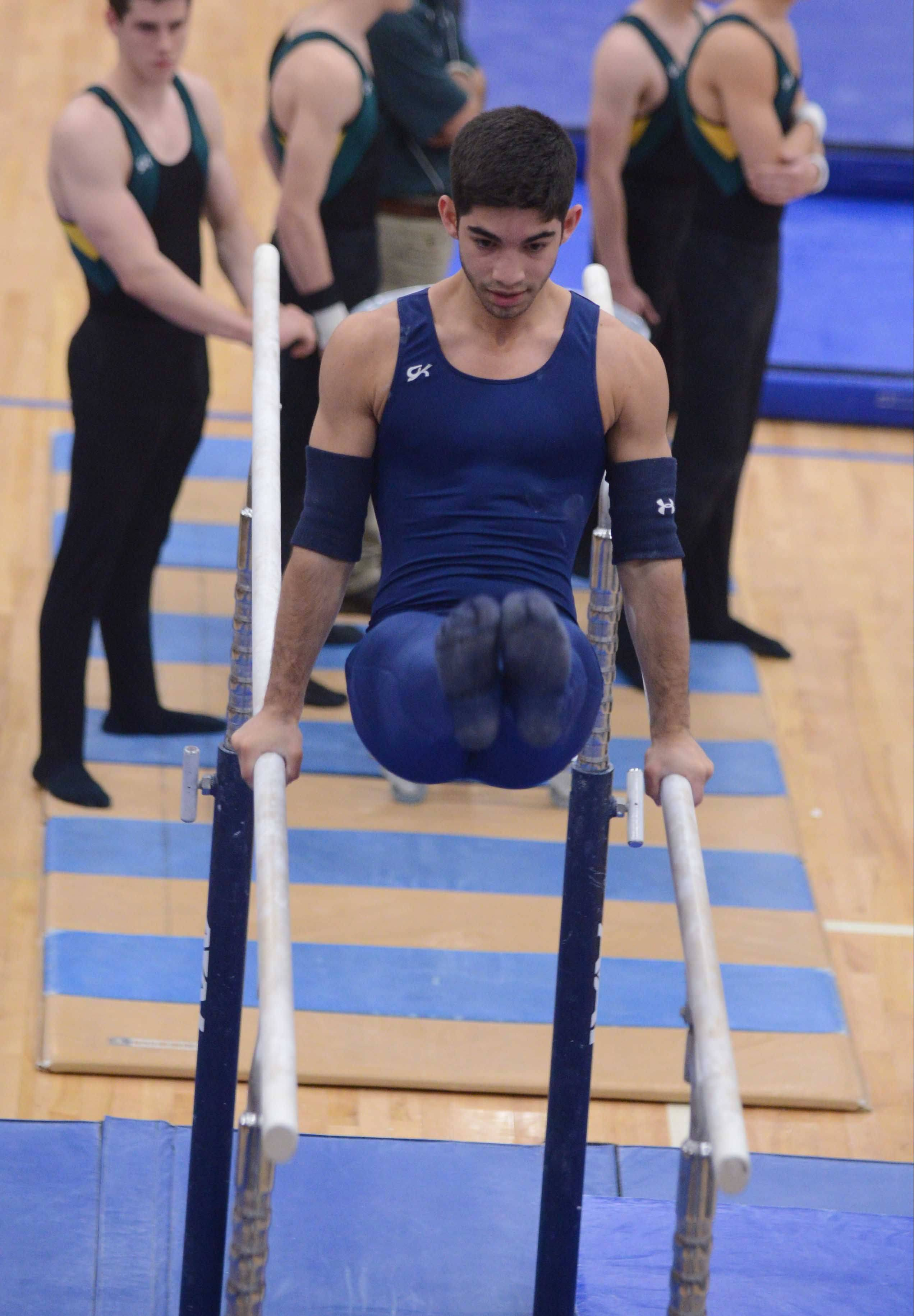 Zac Halap of Buffalo Grove on the parallel bars during the boys gymnastics state finals Friday at Lincoln-Way East.