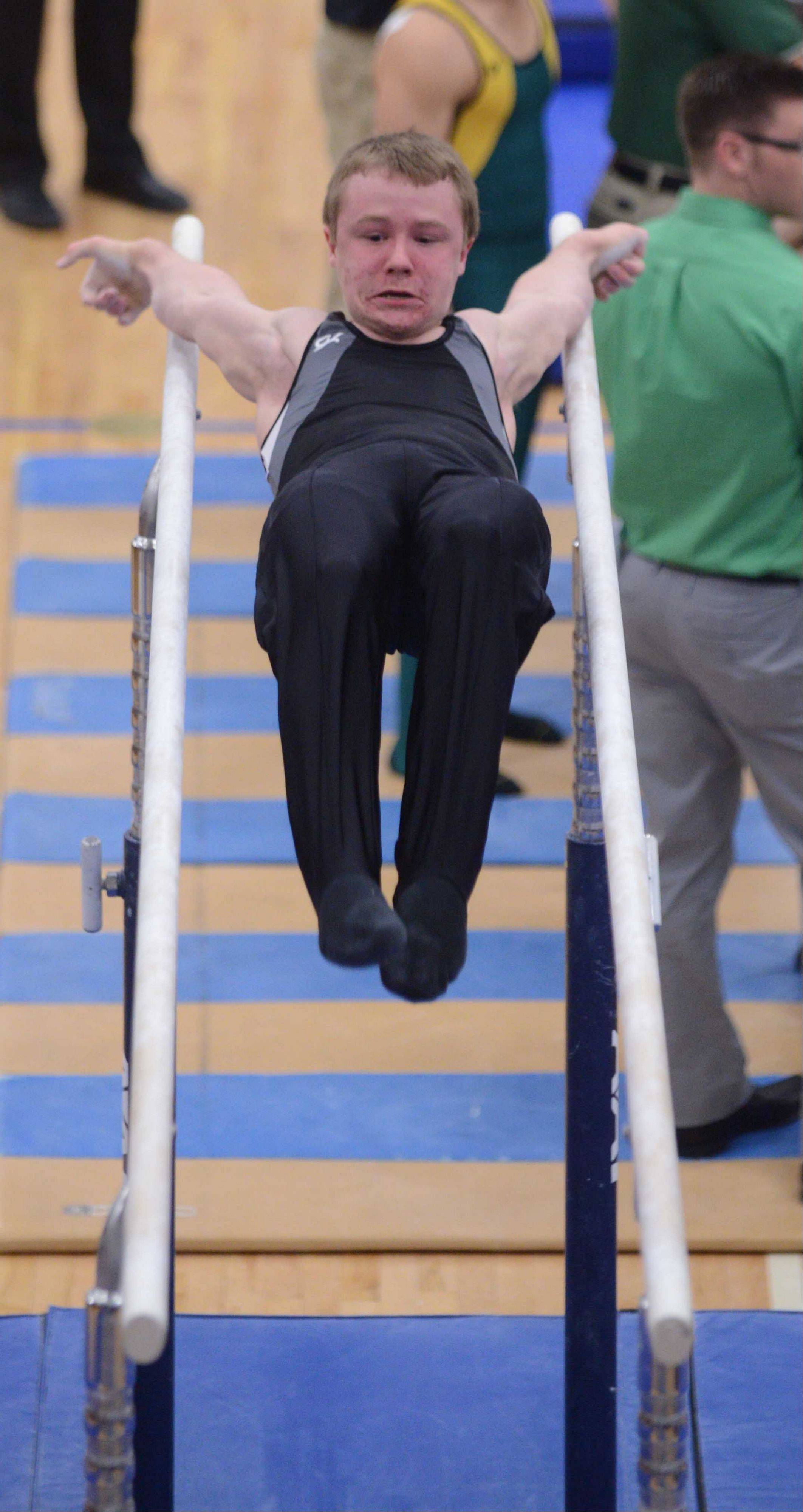 Steve Merena of Elgin performs on the parallel bars during bys gymnastics state finals at Lincoln-Way East in Frankfort on Friday.