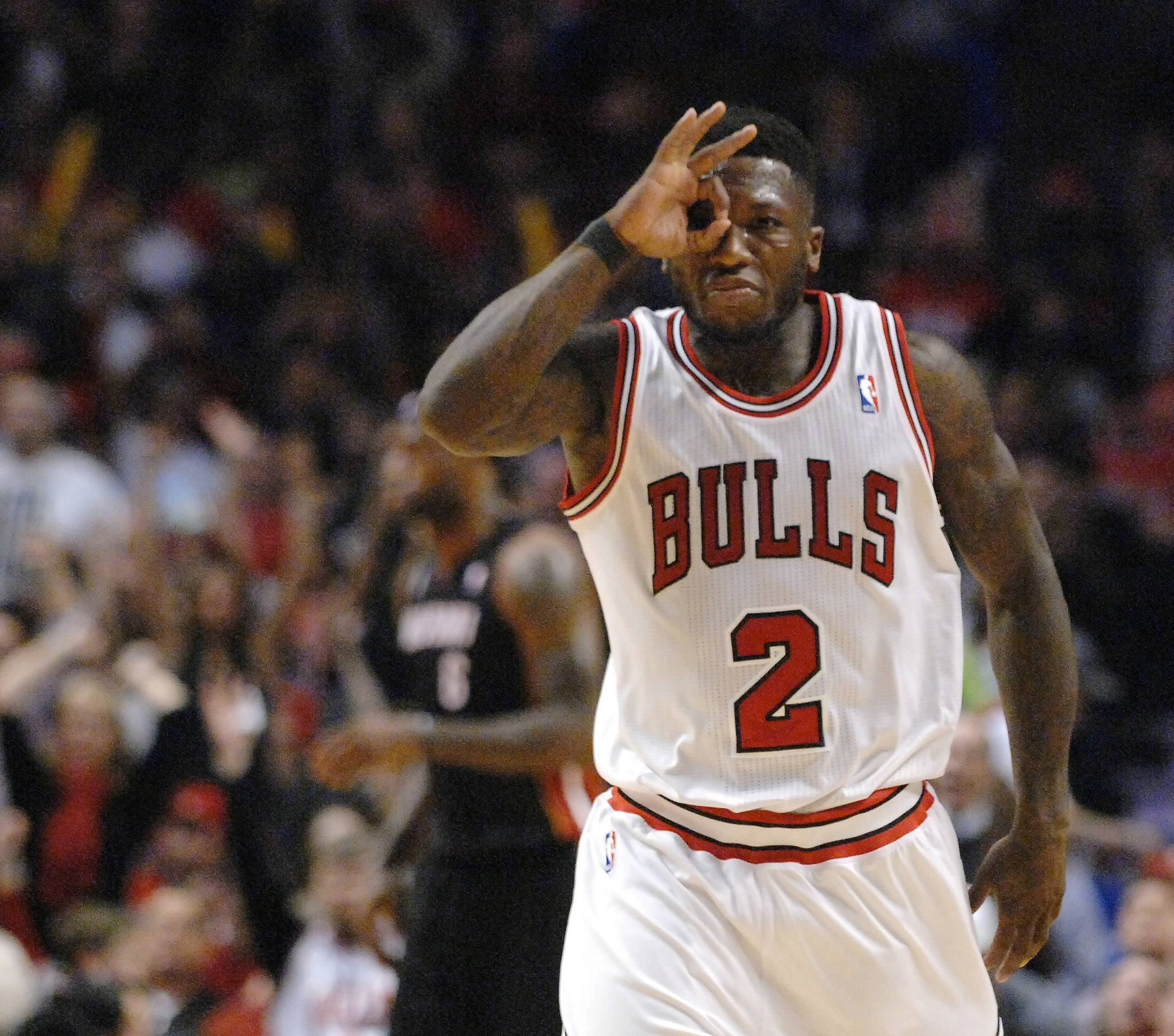 Chicago Bulls point guard Nate Robinson (2) celebrates a three-pointer  during Game 3 of an NBA basketball playoffs Eastern Conference semifinal on Friday, May 10, 2013, in Chicago. The heat won 104-94.
