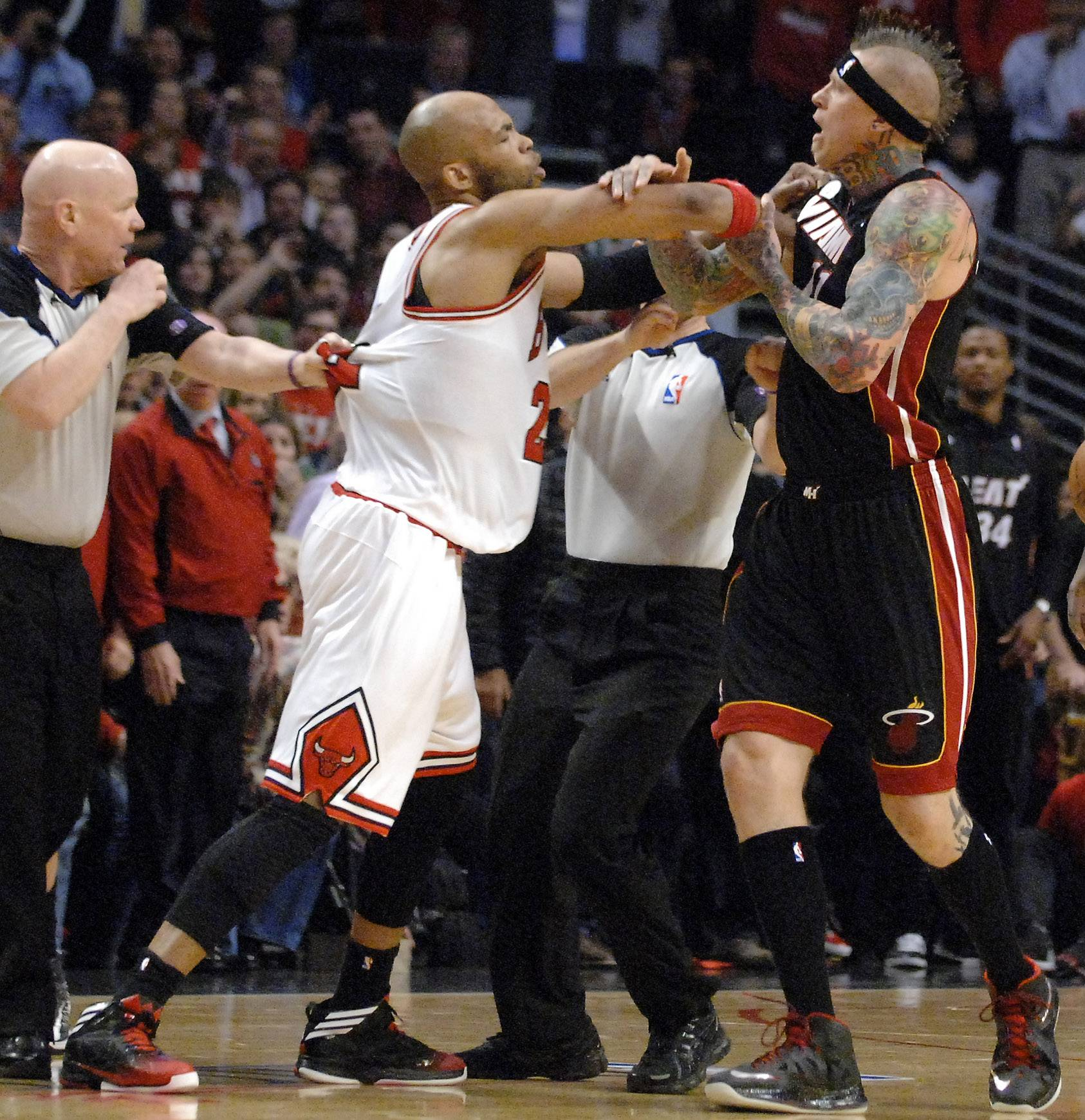 Chicago Bulls power forward Taj Gibson (22) and Miami Heat power forward Chris Andersen (11) get in a shoving match following Nazr Mohammed foul on LeBron James during Game 3 of an NBA basketball playoffs Eastern Conference semifinal on Friday, May 10, 2013, in Chicago. The heat won 104-94.