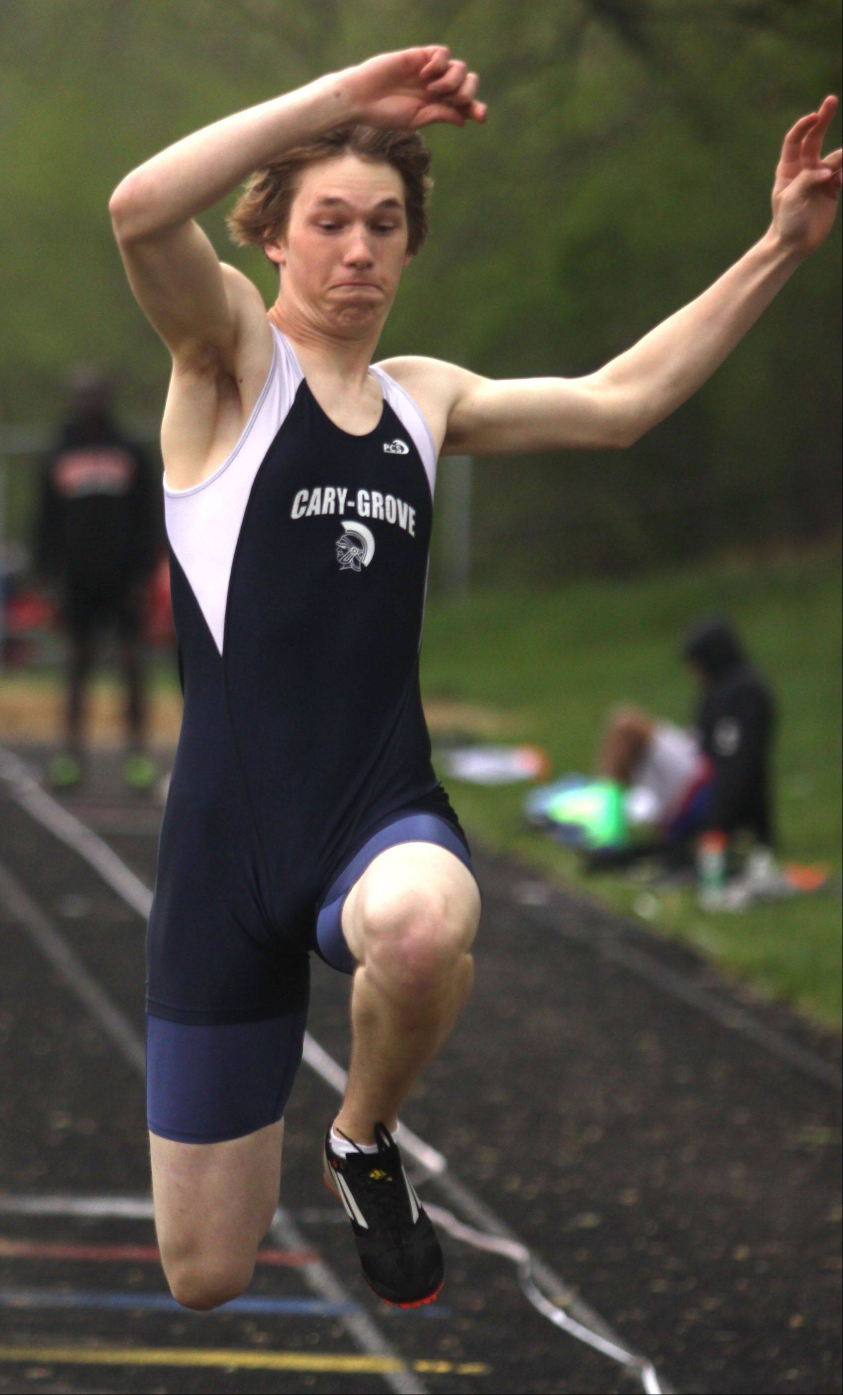 Cary-Grove's Frank San Filippo participates in the triple jump during the Fox Valley Conference Boys Track & Field Championships at Al Bohrer Field on the campus of Cary-Grove High School Friday night.