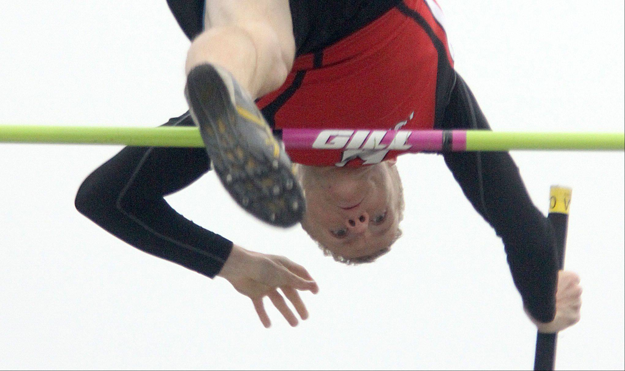 Huntley's Craig Lambert clears 13 feet, 3 inches in the pole vault during the Fox Valley Conference Boys Track & Field Championships at Al Bohrer Field on the campus of Cary-Grove High School Friday night.