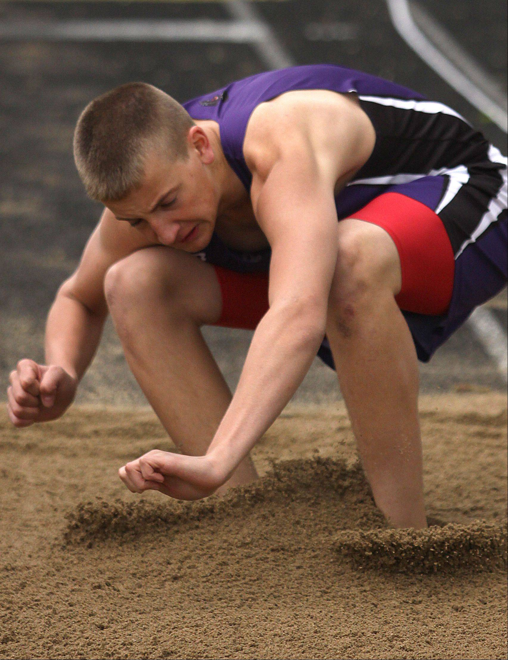 Hampshire's Croy Seagren participates in the triple jump during the Fox Valley Conference Boys Track & Field Championships at Al Bohrer Field on the campus of Cary-Grove High School Friday night.