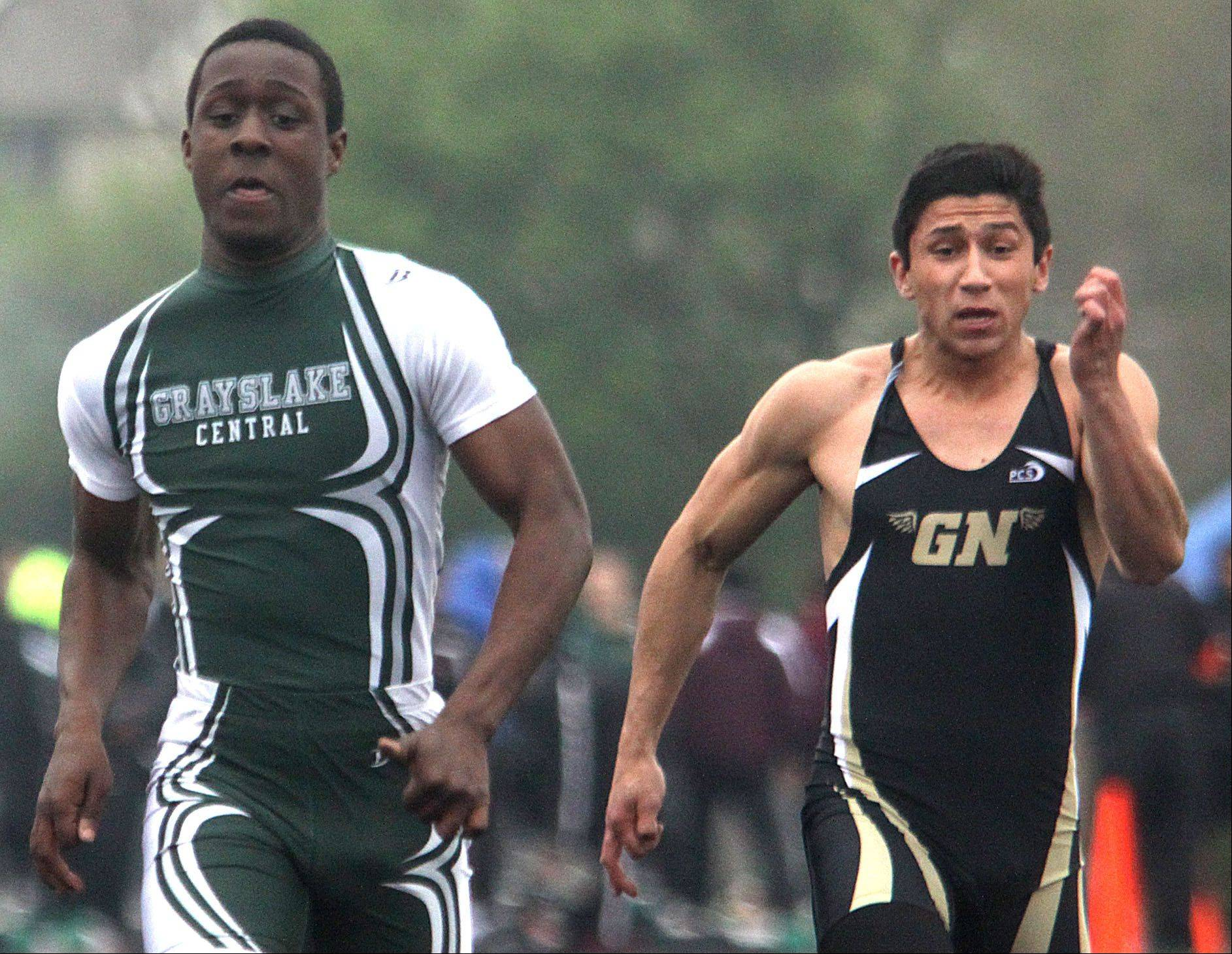 Grayslake Central's Davonta Jennings, left, and Grayslake North's Alex Rotter participate in the 100-meter dash prelims during the Fox Valley Conference Boys Track & Field Championships at Al Bohrer Field on the campus of Cary-Grove High School Friday night.