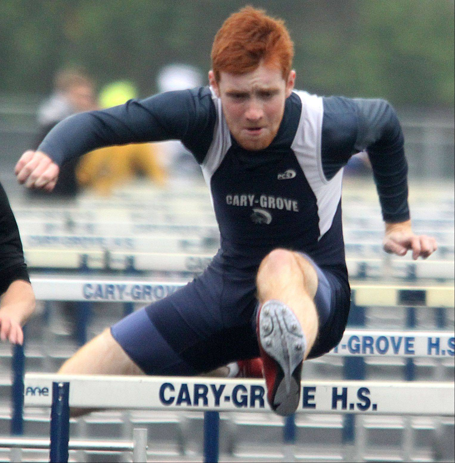 Cary-Grove's Michael Saxon participates in the 110-meter high hurdles semifinal during the Fox Valley Conference Boys Track & Field Championships at Al Bohrer Field on the campus of Cary-Grove High School Friday night.