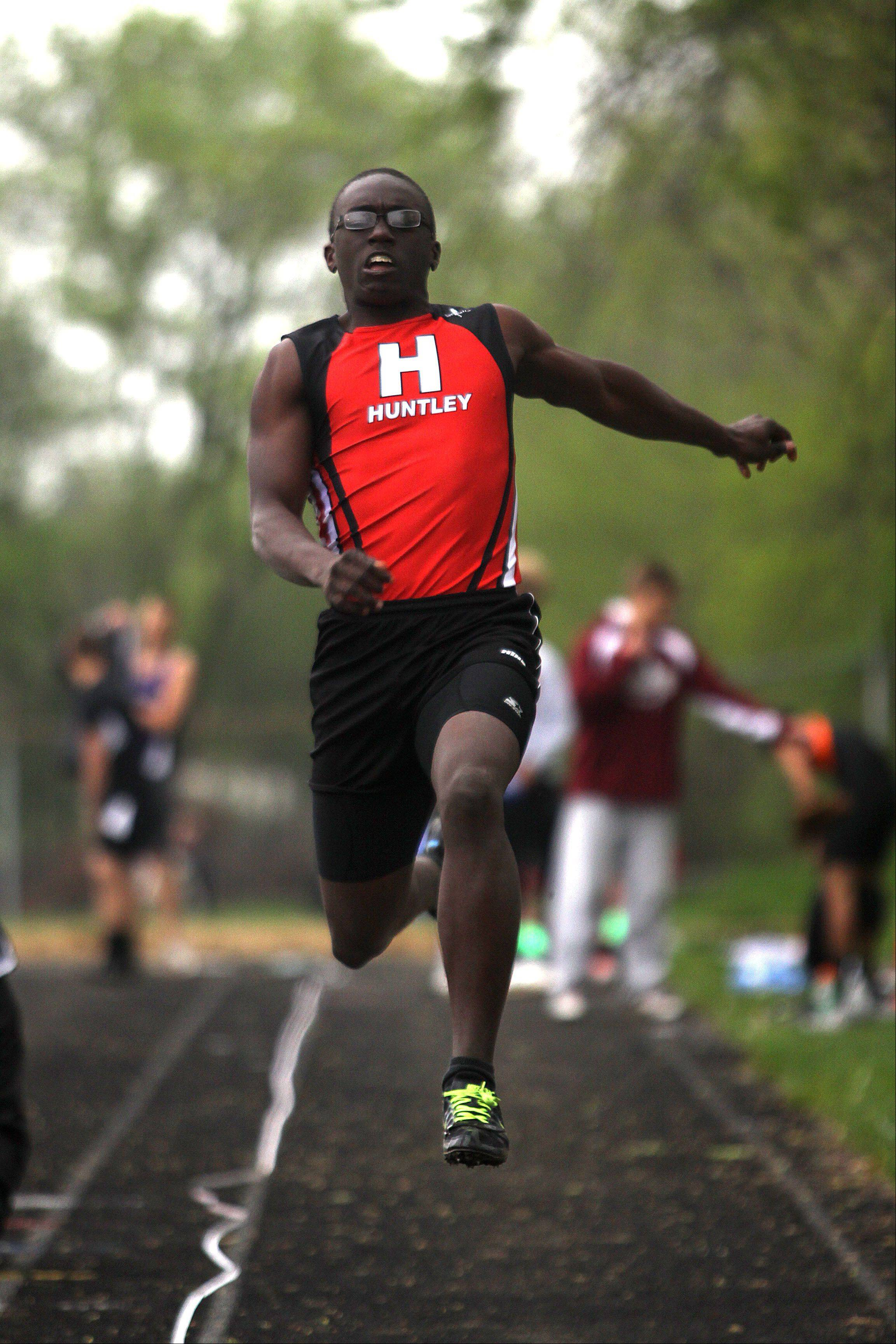 Huntley's Tim McCloyn participates in the long jump during the Fox Valley Conference Boys Track & Field Championships at Al Bohrer Field on the campus of Cary-Grove High School Friday night.