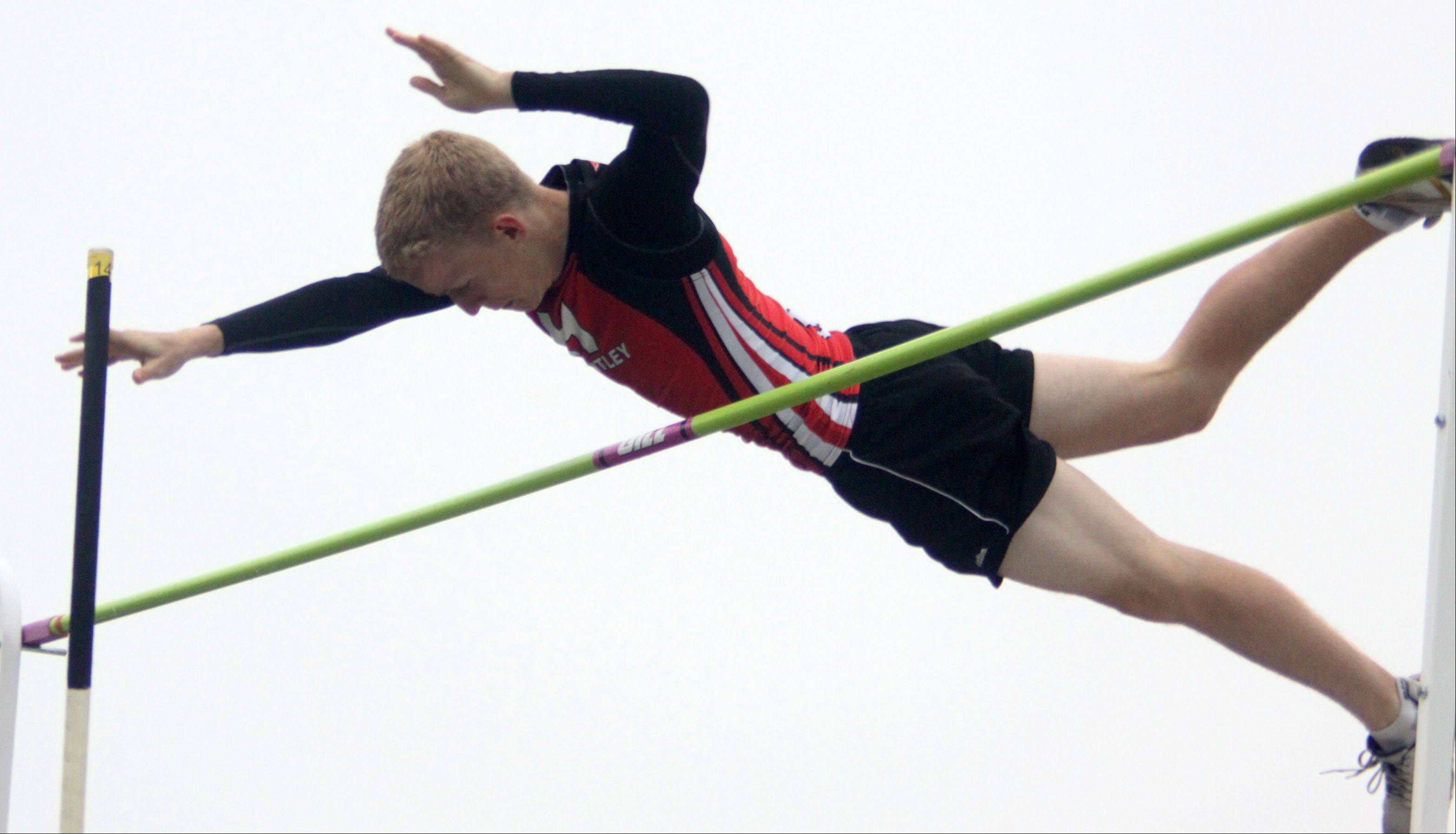 Huntley's Craig Lambert clears 12 feet, 9 inches in the pole vault during the Fox Valley Conference Boys Track & Field Championships at Al Bohrer Field on the campus of Cary-Grove High School Friday night.