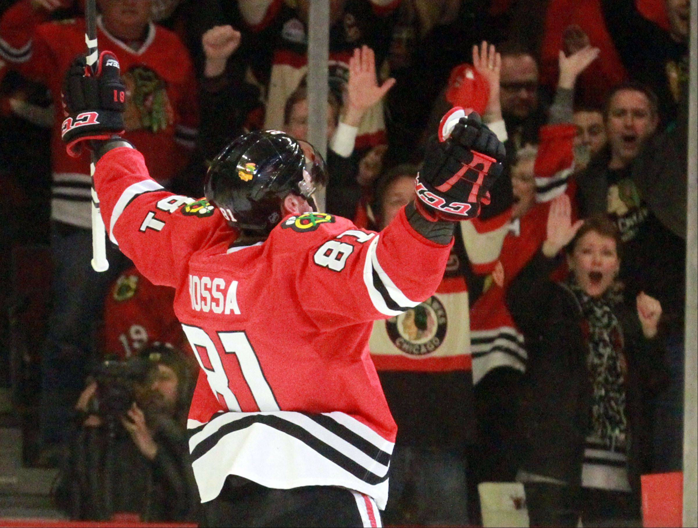 Chicago Blackhawks right wing Marian Hossa celebrates his second goal of the game.