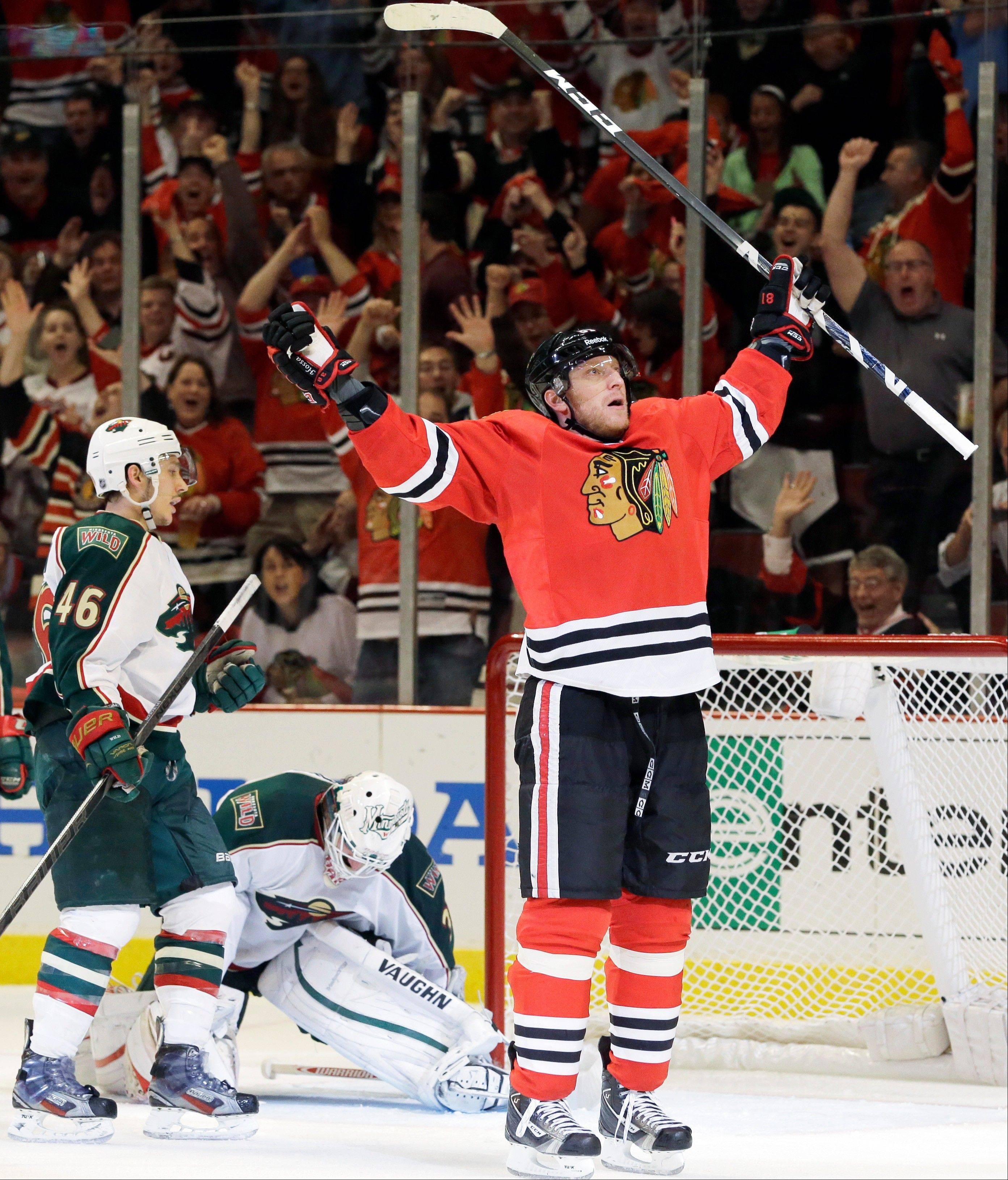 Chicago Blackhawks' Marian Hossa, right, celebrates after scoring his second goal as Minnesota Wild goalie Josh Harding (37) and Jared Spurgeon (46) react during the second period of Game 5 of an NHL hockey Stanley Cup first-round playoff series in Chicago, Thursday, May 9, 2013.