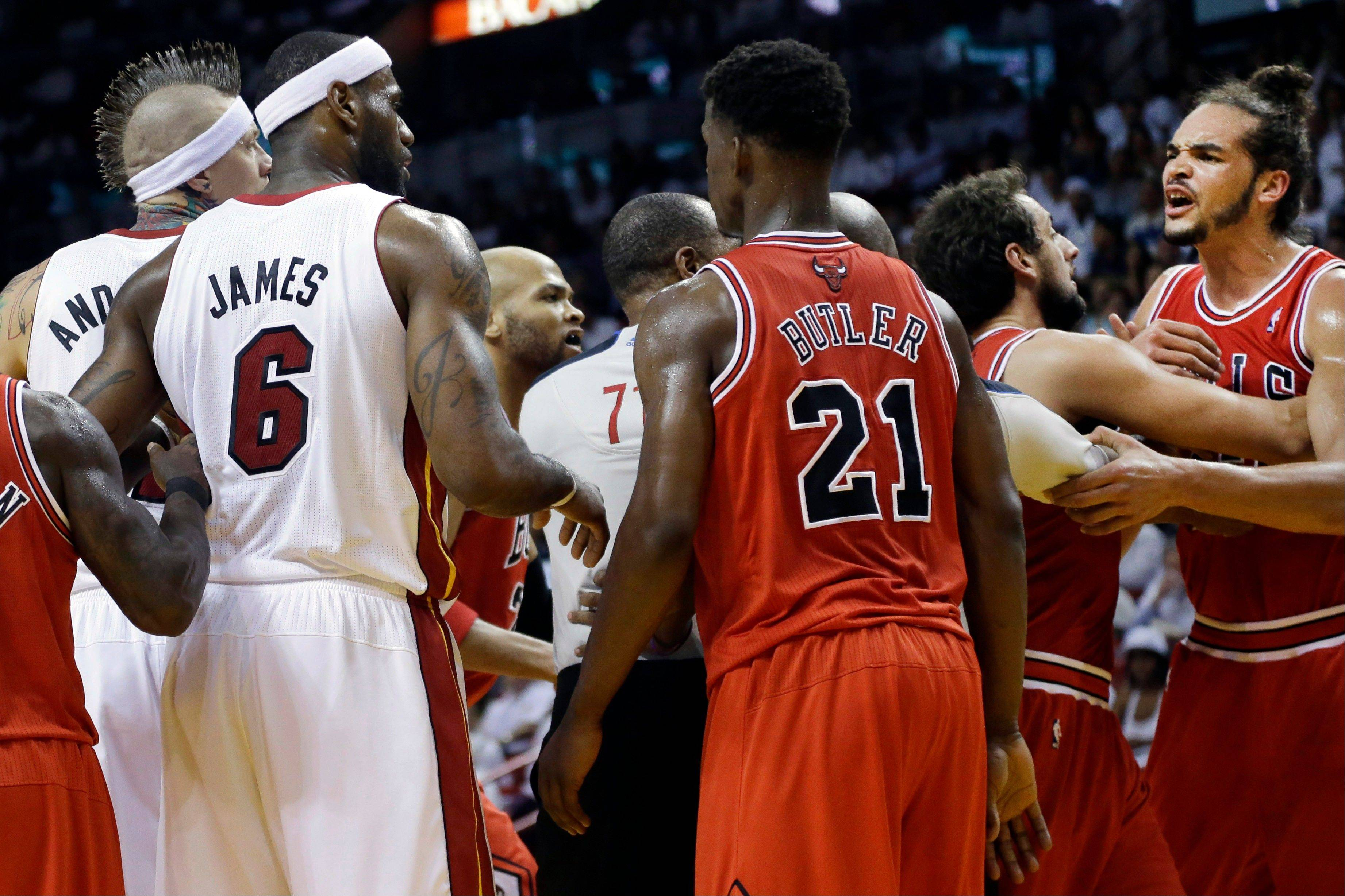 Bulls center Joakim Noah, far right, yells after he and Miami Heat forward LeBron James received technical fouls Wednesday in Game 2 of their NBA Eastern Conference semifinals.