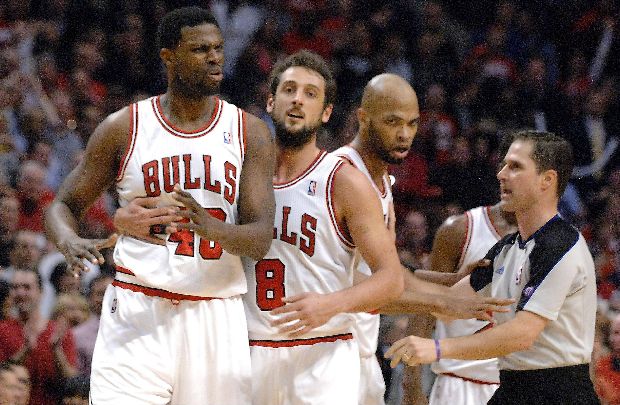 Teammates hold back Chicago Bulls center Nazr Mohammed (48) after his foul on Miami Heat small forward LeBron James (6) during game 3 of the NBA Eastern Conference semifinals at the United Center in Chicago Friday.