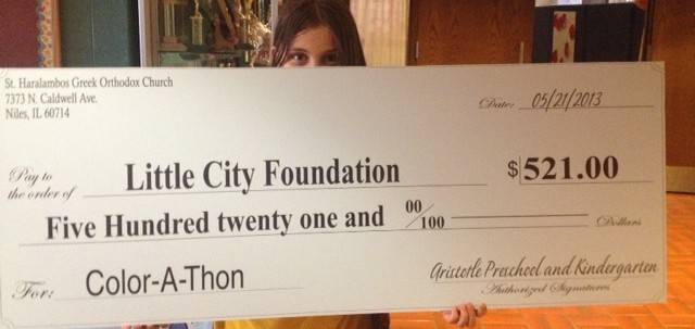 Color-A-Thon a huge success!  Alexandra is seen here holding the check that will be presented to the Little City Foundation.