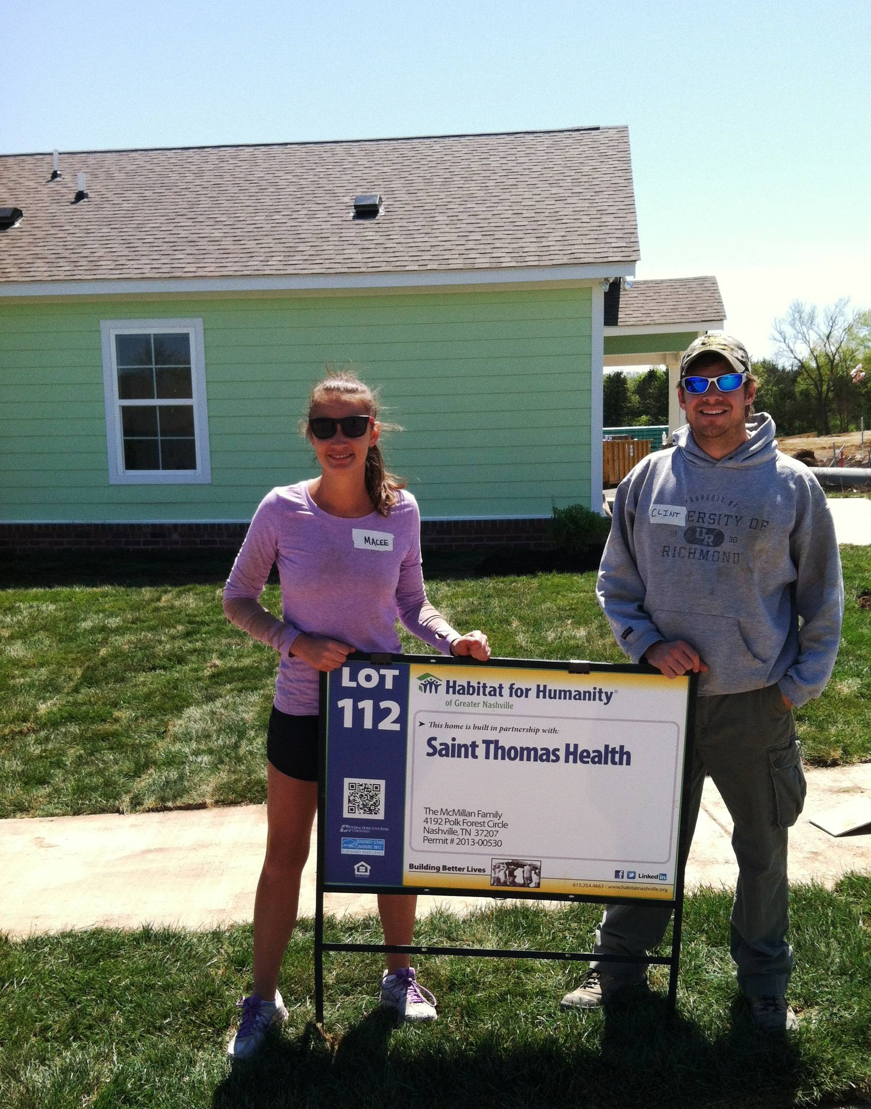 Accretive Health employees teamed up with St. Thomas Health and Baptist Volunteer Services in Nashville, Tenn., to build houses for Habitat for Humanity. Pictured at the worksite are Accretive Health employees Macee Bumpus (left) and Clint Anderson (right).
