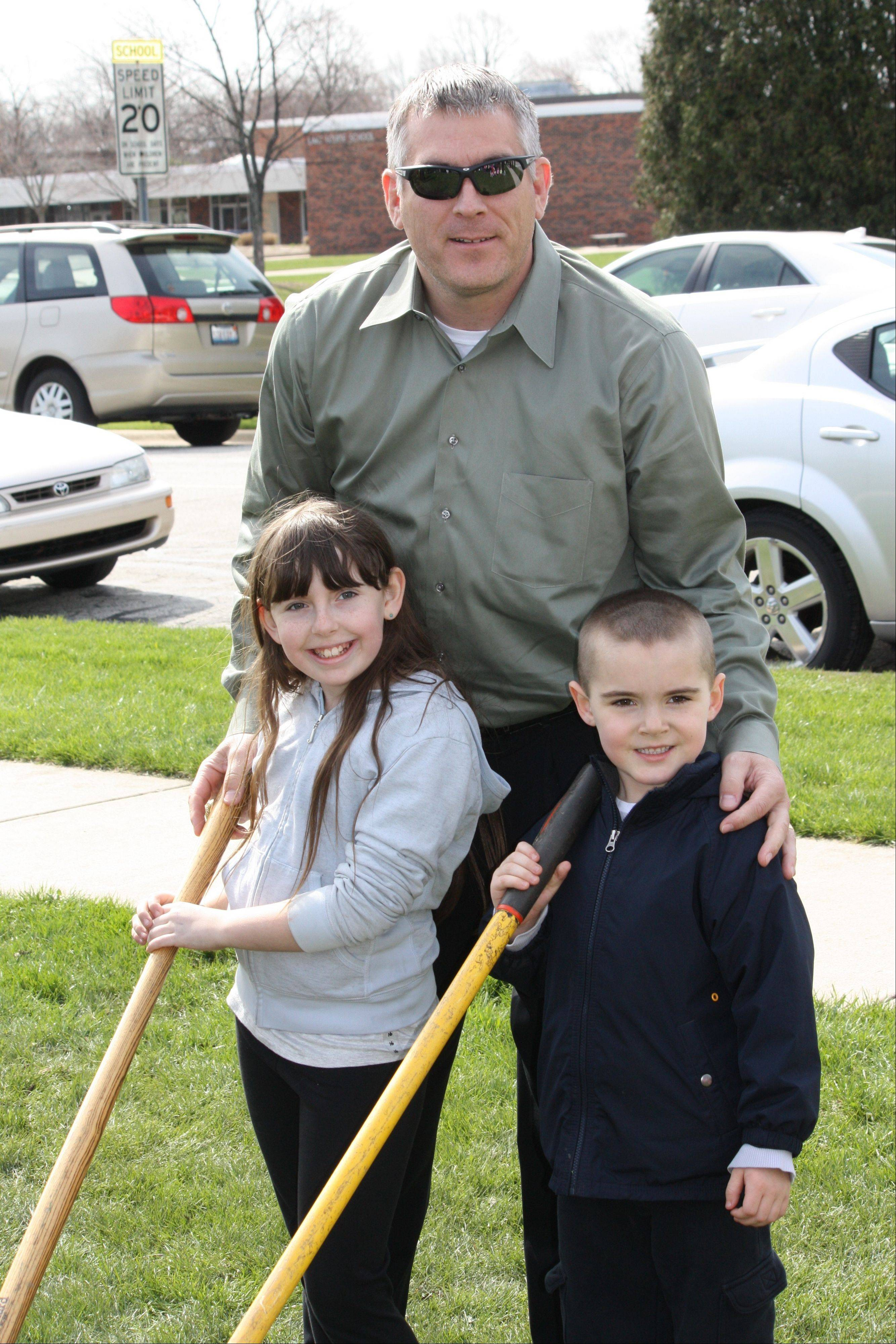 Mayor Jim Schwantz with Lake Louise fourth-grader Jordan Bolber and Maple Park preschooler RJ Seifert at the Palatine Arbor Day celebration.