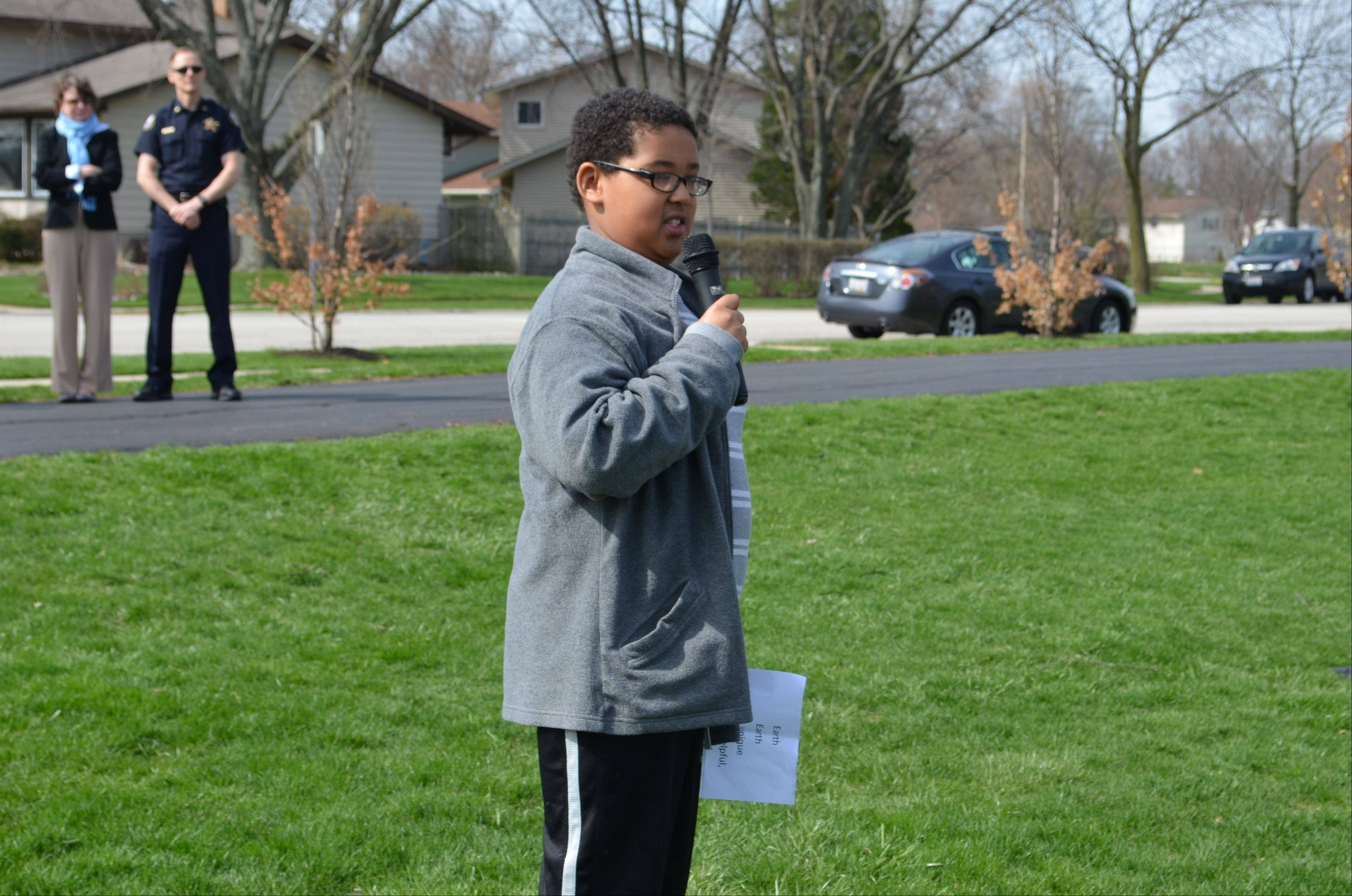 "Lake Louise fourth-grader Adam Monnette reads his poem titled ""Earth."""