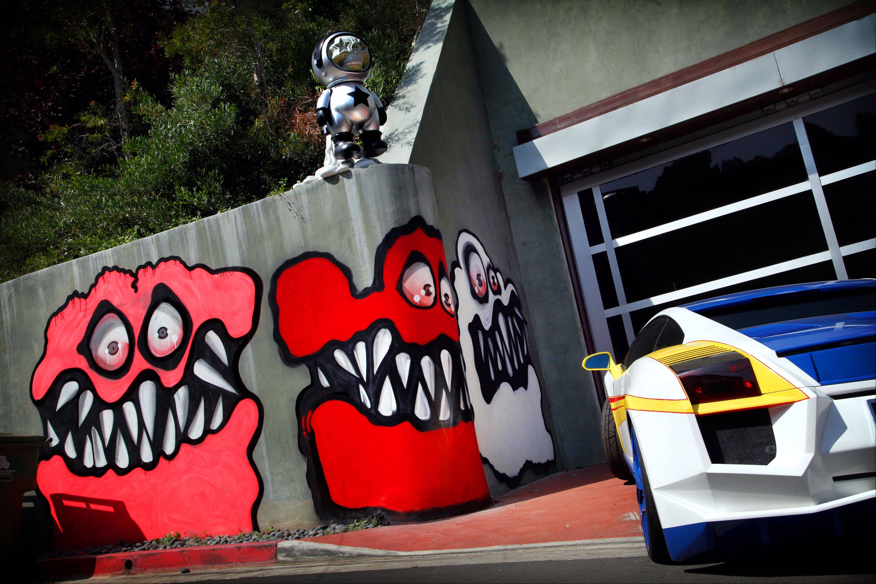 Neighbors are angry at Chris Brown�s street art painted outside his home and local residents are calling for fines to be brought against the pop star and demanding Brown remove the street art.