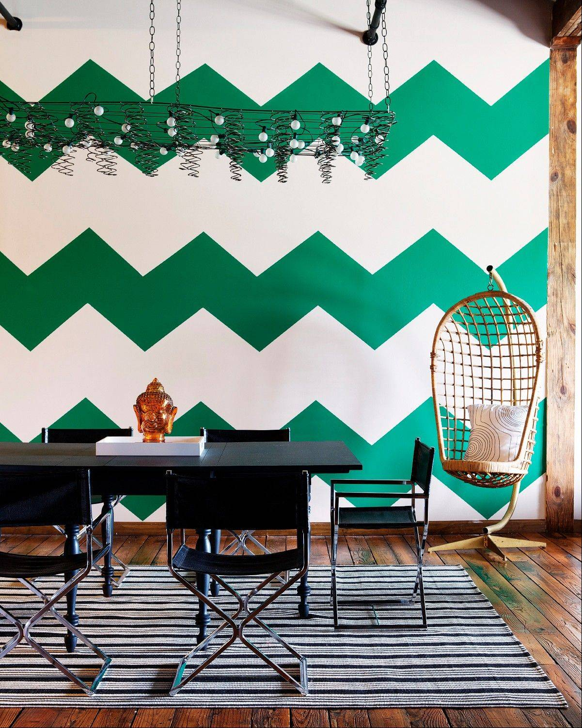 Stencils create the look of patterned wallpaper on a rental apartment wall, as seen here in �The First Apartment Book: Cool Design for Small Spaces,� by Kyle Schuneman.