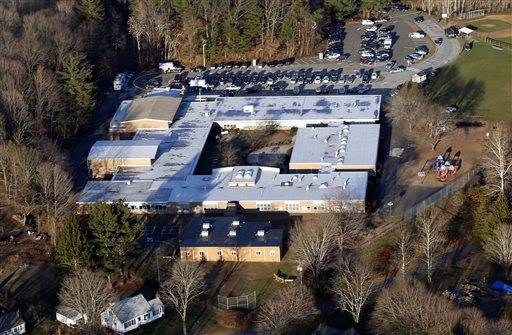 This photo shows Sandy Hook Elementary School in Newtown, Conn., where a gunman shot 27 people dead, including 20 children. A task force of elected officials in Newtown on Friday, May 10, 2013 recommended tearing down the school and rebuilding on the same site.