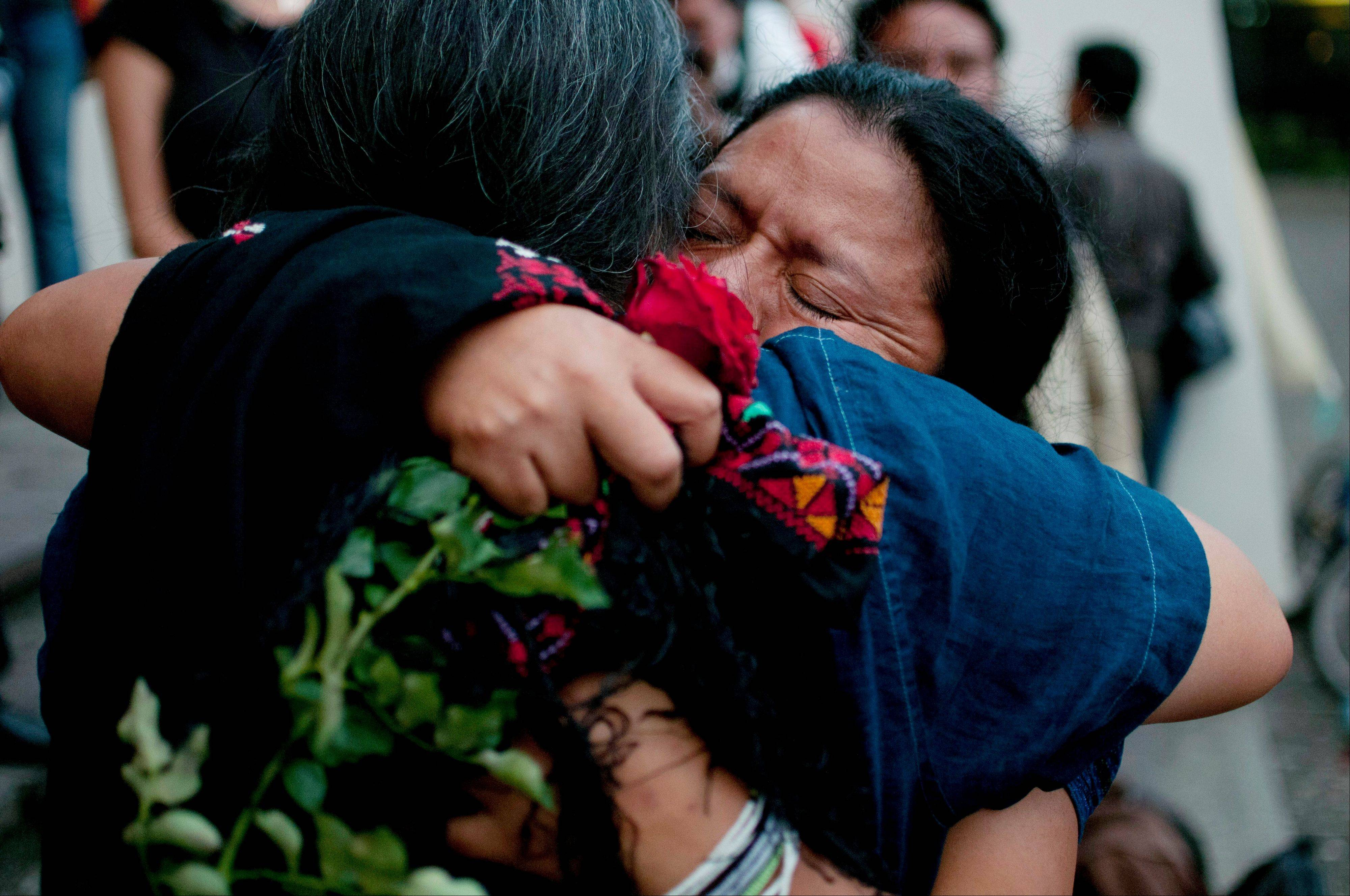 The relatives of people who were killed in the country's civil war embrace after the judge's guilty verdict Friday for Guatemala's former dictator Jose Efrain Rios Montt.