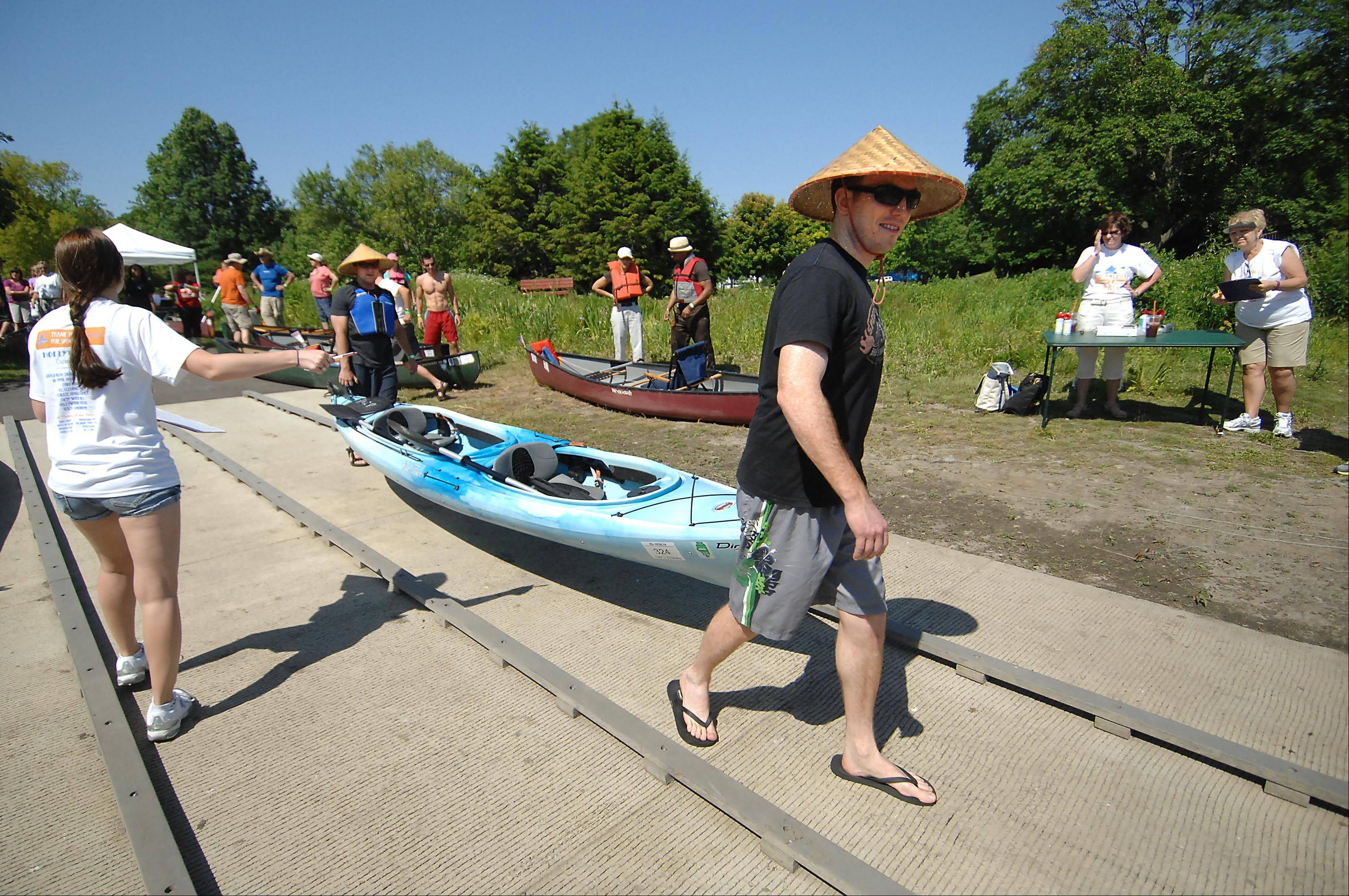 Kevin Driscoll of Chicago, right, and Joe Pietro of Sugar Grove carry their two-man kayak to the water in Mount St. Mary�s Park at the Mid-American Canoe and Kayak Race on the Fox River in St. Charles. This year�s race is June 2.