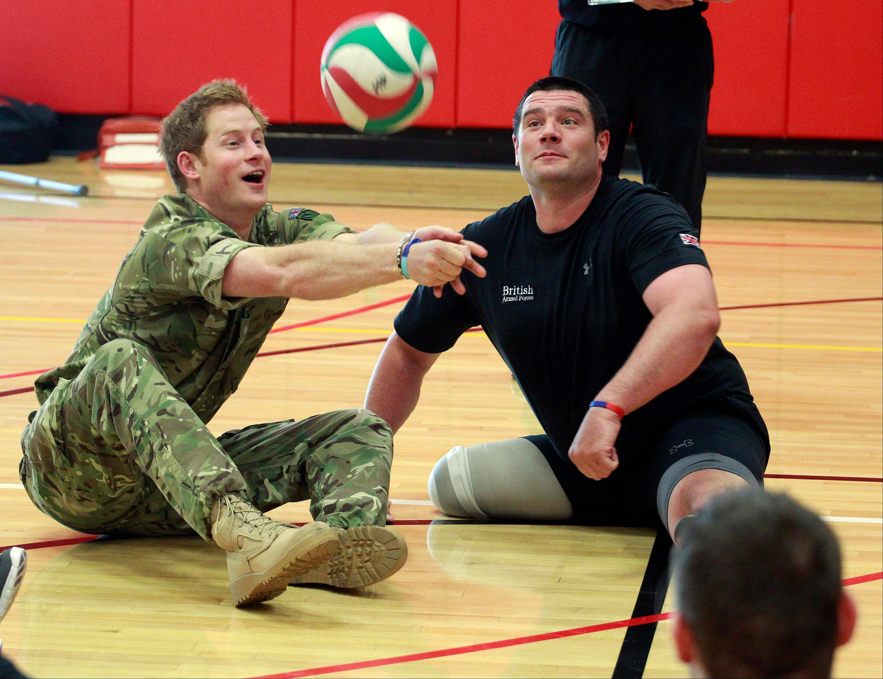 Prince Harry plays volleyball with members of the British Warrior Games Team Saturday in a gymnasium before the opening of the 2013 Warrior Games, at the U.S. Olympic Training Center, in Colorado Springs, Colo.