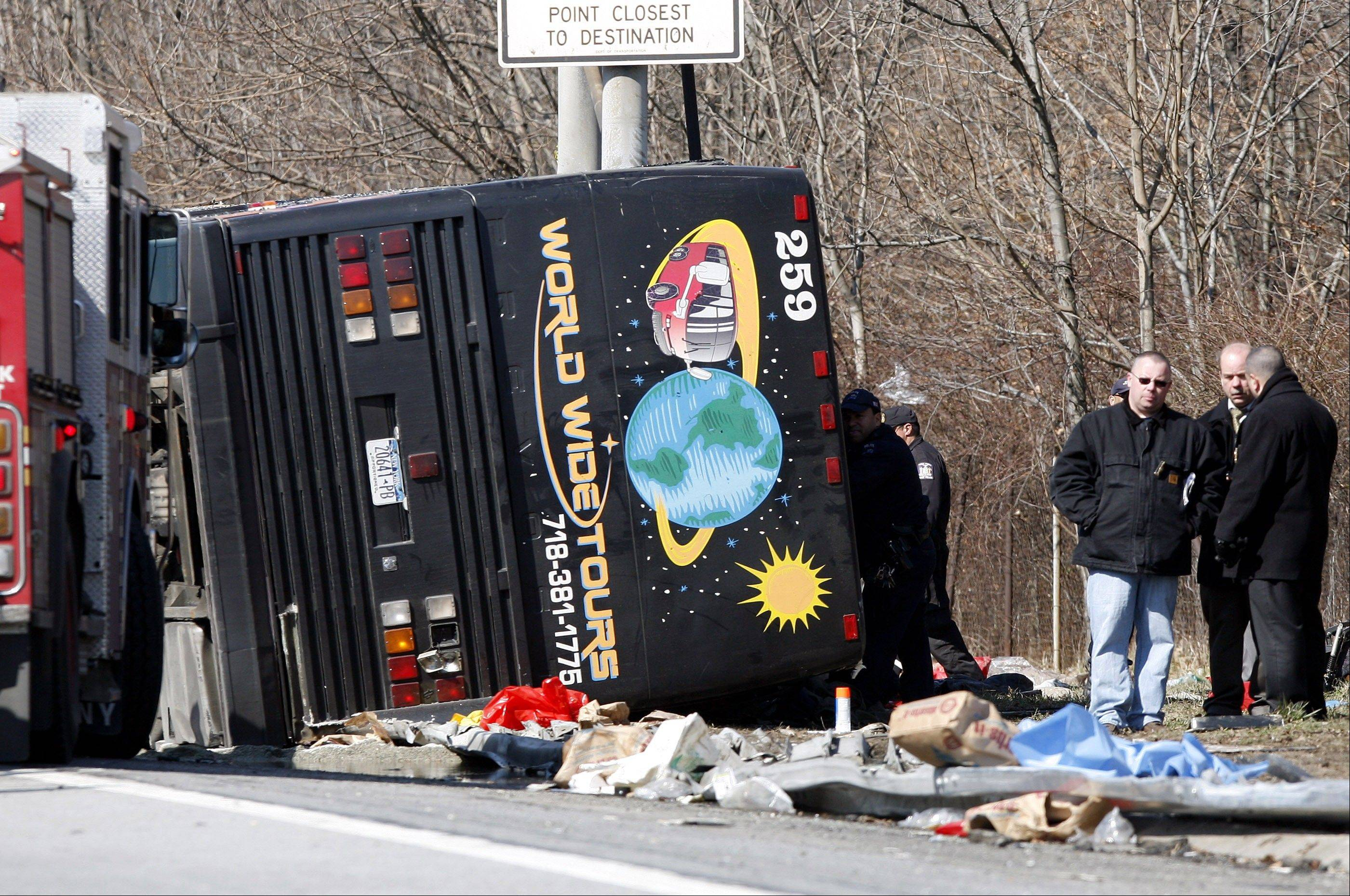 Emergency personnel investigate the scene of a bus crash on Interstate 95 in the Bronx borough of New York. Prosecutors in New York alleged the driver, Ophadell Williams, was all but asleep at the wheel, but a jury decided there was not enough proof to convict him.