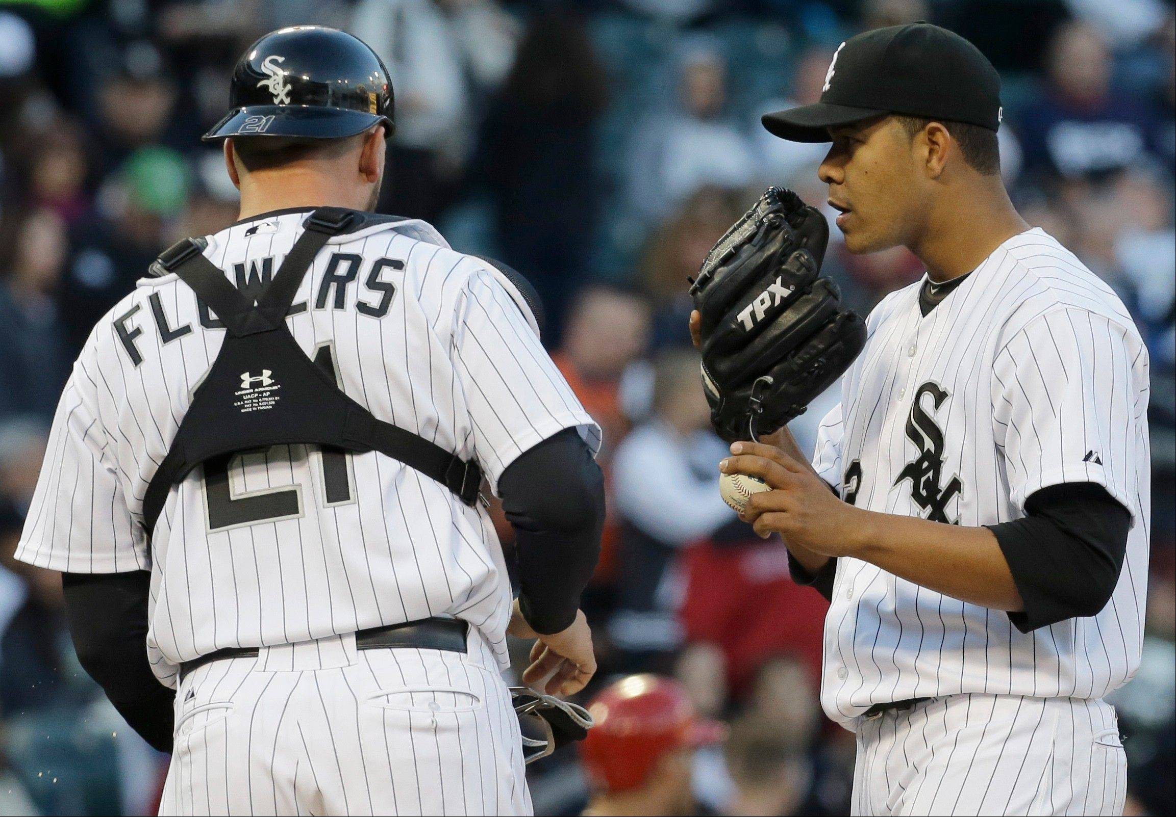 White Sox starter Jose Quintana talks to catcher Tyler Flowers during the third inning, when the Angels scored the go-ahead run on a Flowers passed ball.