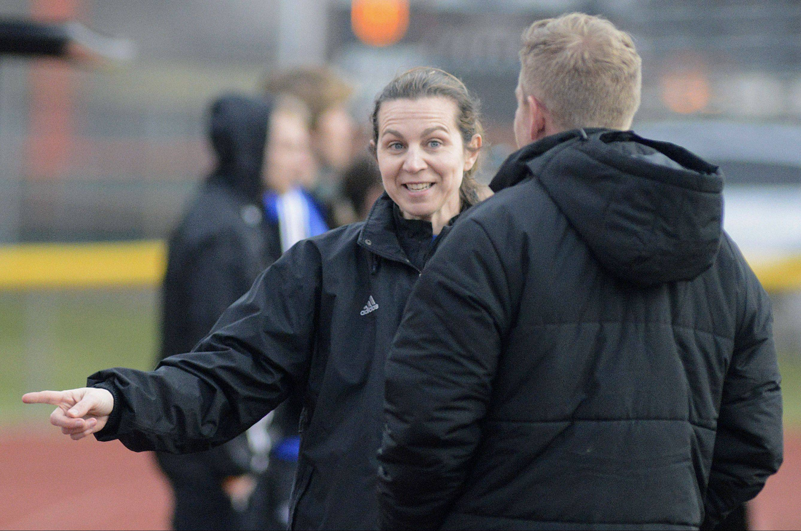 St. Charles North coach Ruth Vostal and St. Charles East coach Paul Jennison, pictured before the teams played in the regular season last month, could see their squads meet again for the Class 3A Hoffman Estates sectional championship May 24.
