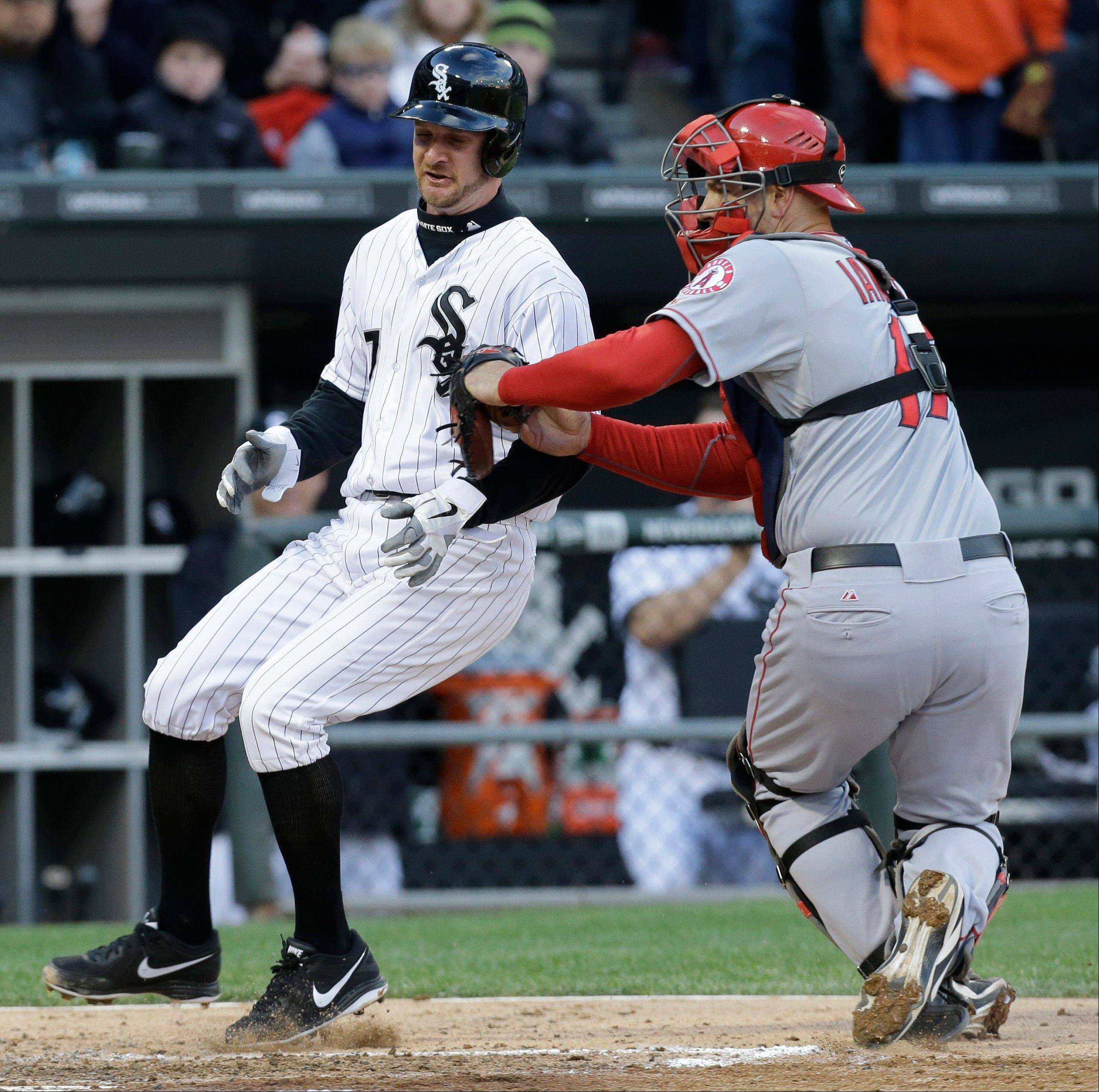 Los Angeles Angels catcher Chris Iannetta, right, tags out Chicago White Sox�s Jeff Keppinger at home during the second inning of a baseball game in Chicago, Saturday, May 11, 2013.