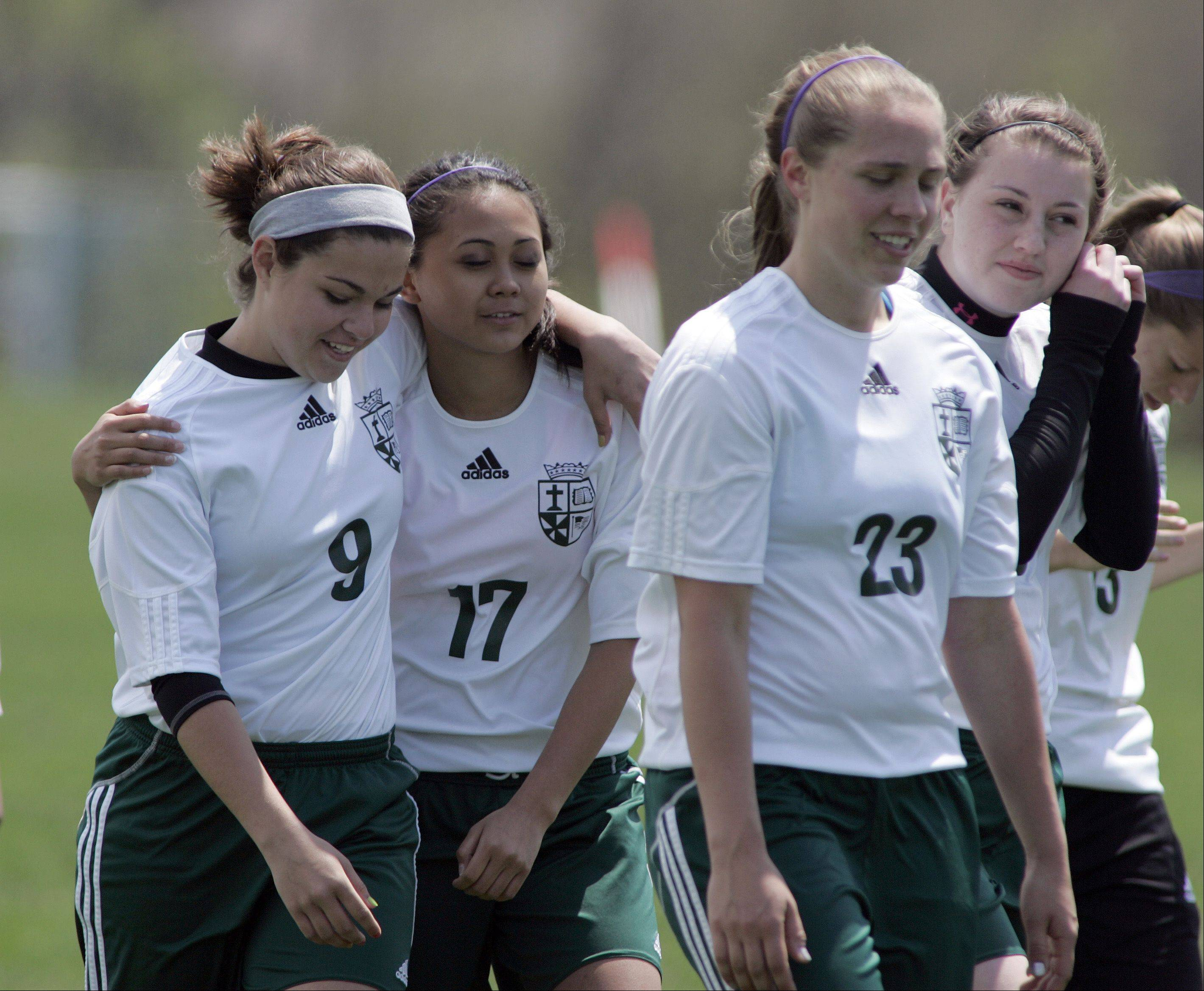 St. Edward�s girls soccer team returns to the sideline after beating Westminster Christian in the Class 1A Westminster regional final Saturday. Alyssa Saunders (9) and Stephanie Manghas (17) celebrate in the middle.