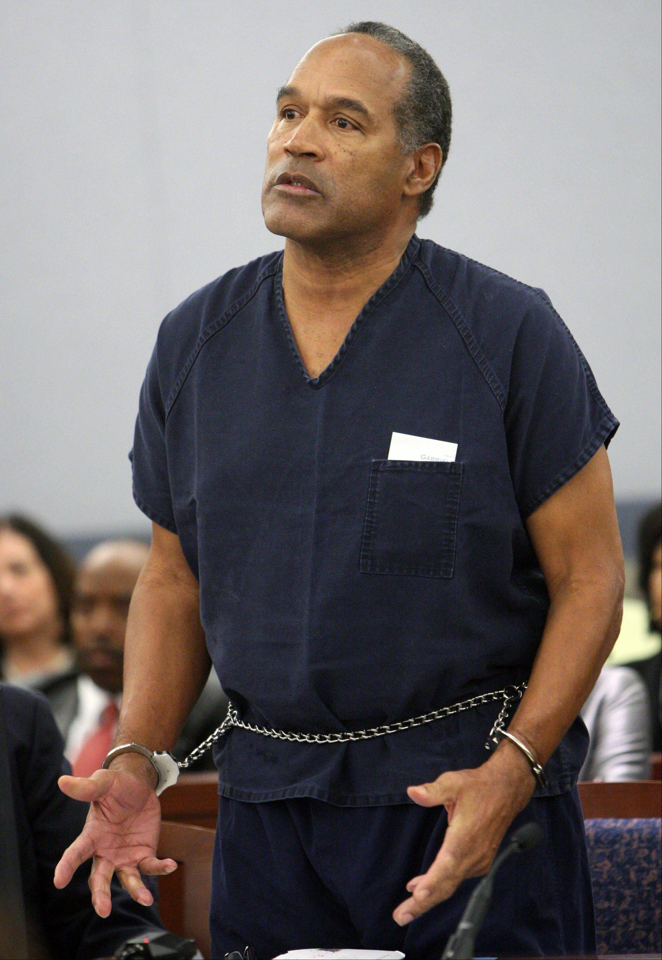 In this Dec. 5, 2008 file photo, O.J. Simpson speaks during his sentencing at the Clark County Regional Justice Center courtroom in Las Vegas. Simpson is heading back to the Las Vegas courthouse where he was convicted of leading five men in an armed sports memorabilia heist to ask a judge for a new trial because, he says, the Florida lawyer he paid nearly $700,000 botched his defense. The return of O.J. Simpson to a Las Vegas courtroom next Monday, May, 13, will remind Americans of a tragedy that became a national obsession and in the process changed the country's attitude toward the justice system, the media and celebrity.