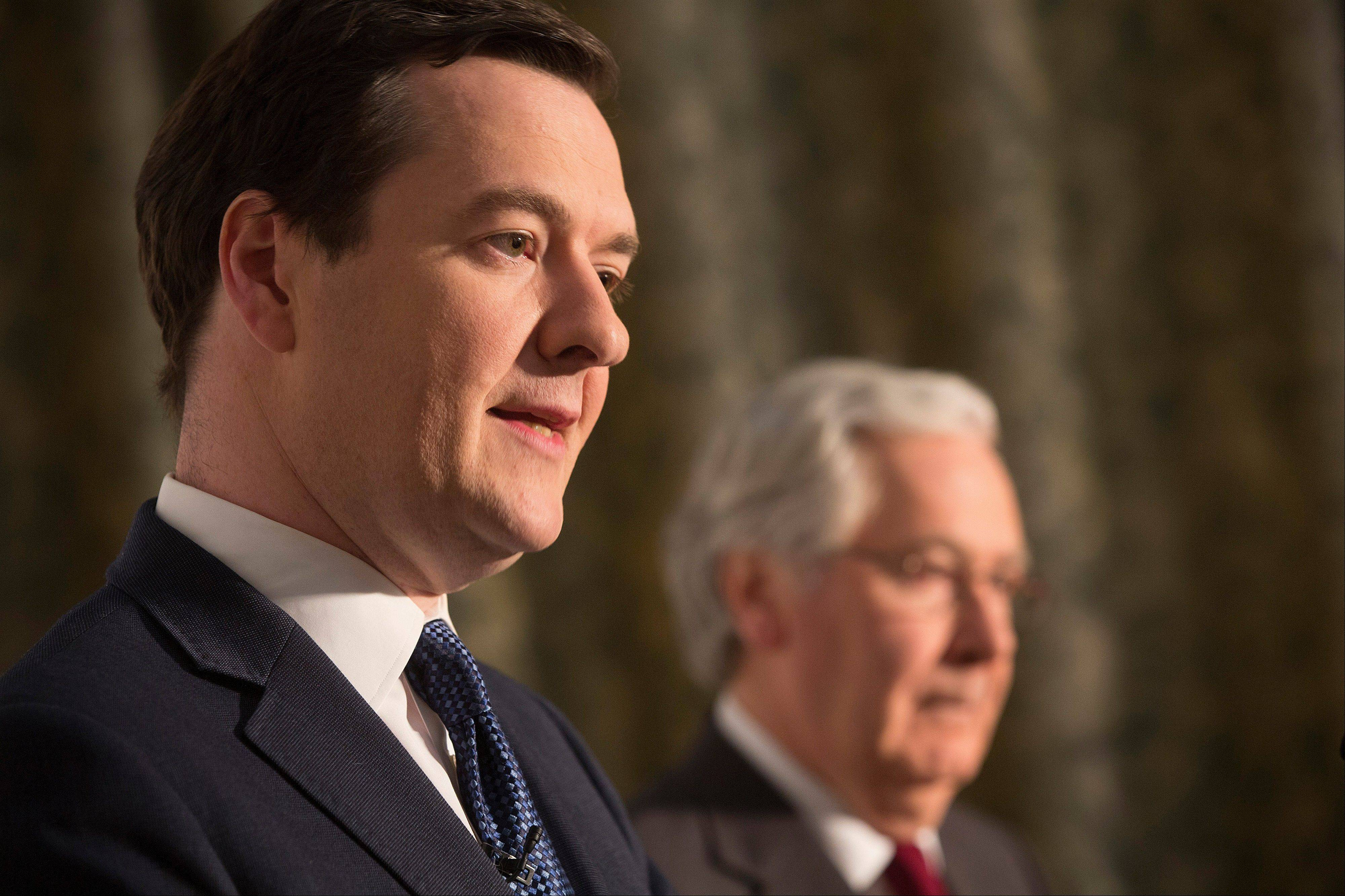 Mervyn King, governor of the Bank of England, right, listens while George Osborne, U.K. chancellor of the exchequer, speaks during a news conference Saturday at the Group of Seven (G-7) finance ministers and central bank governors meeting at Hartwell House in Aylesbury, U.K.