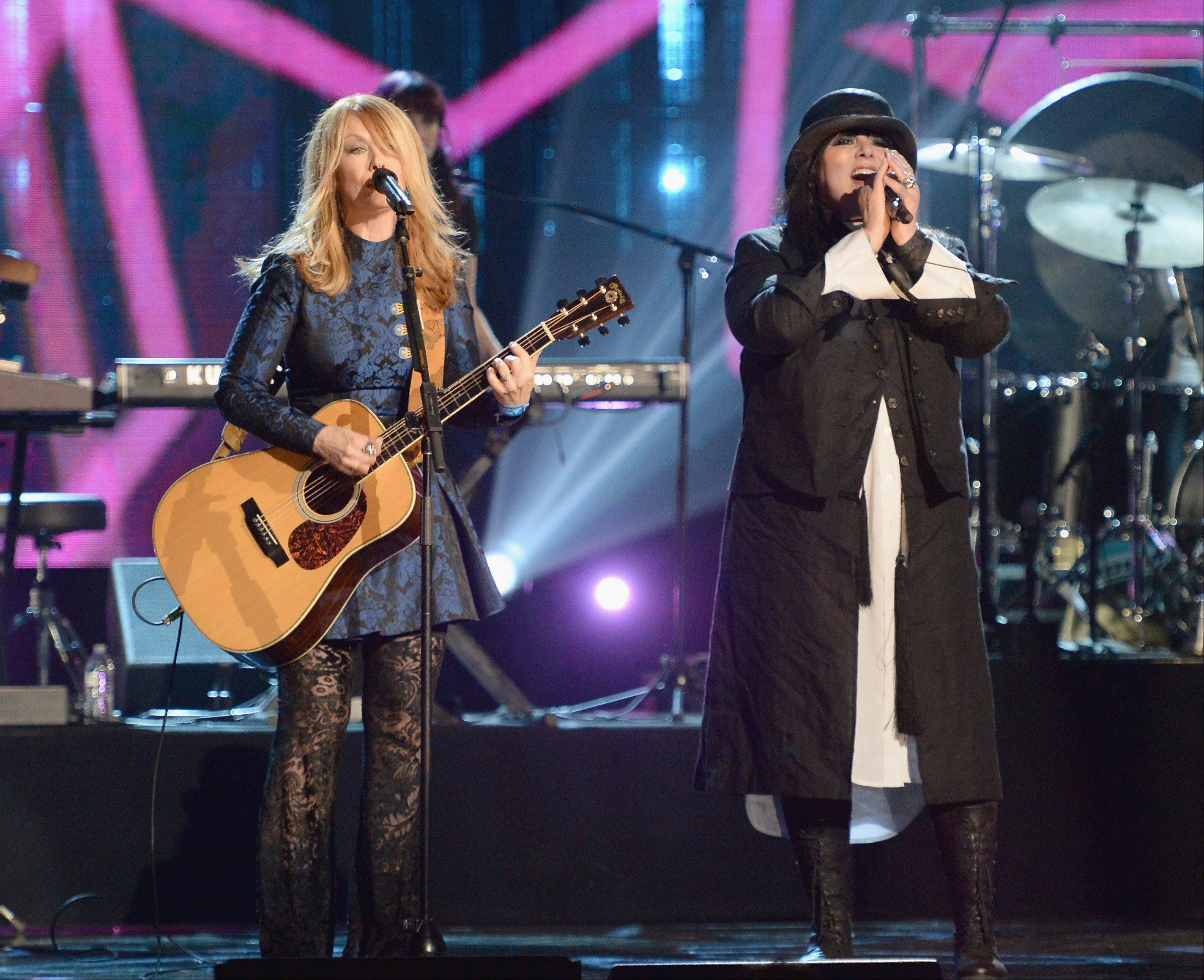 Inductees Nancy Wilson, left, and Ann Wilson of Heart perform onstage during the 28th Annual Rock and Roll Hall of Fame Induction Ceremony in Los Angeles. The ceremony will air May 18 on HBO.