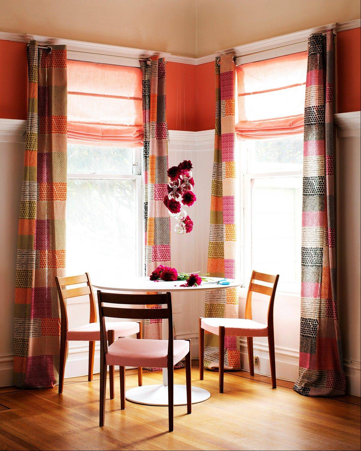 Colorful fabrics, such as theses drapes, are great for making an aprtment yours, especially if you are not allowed to paint walls.
