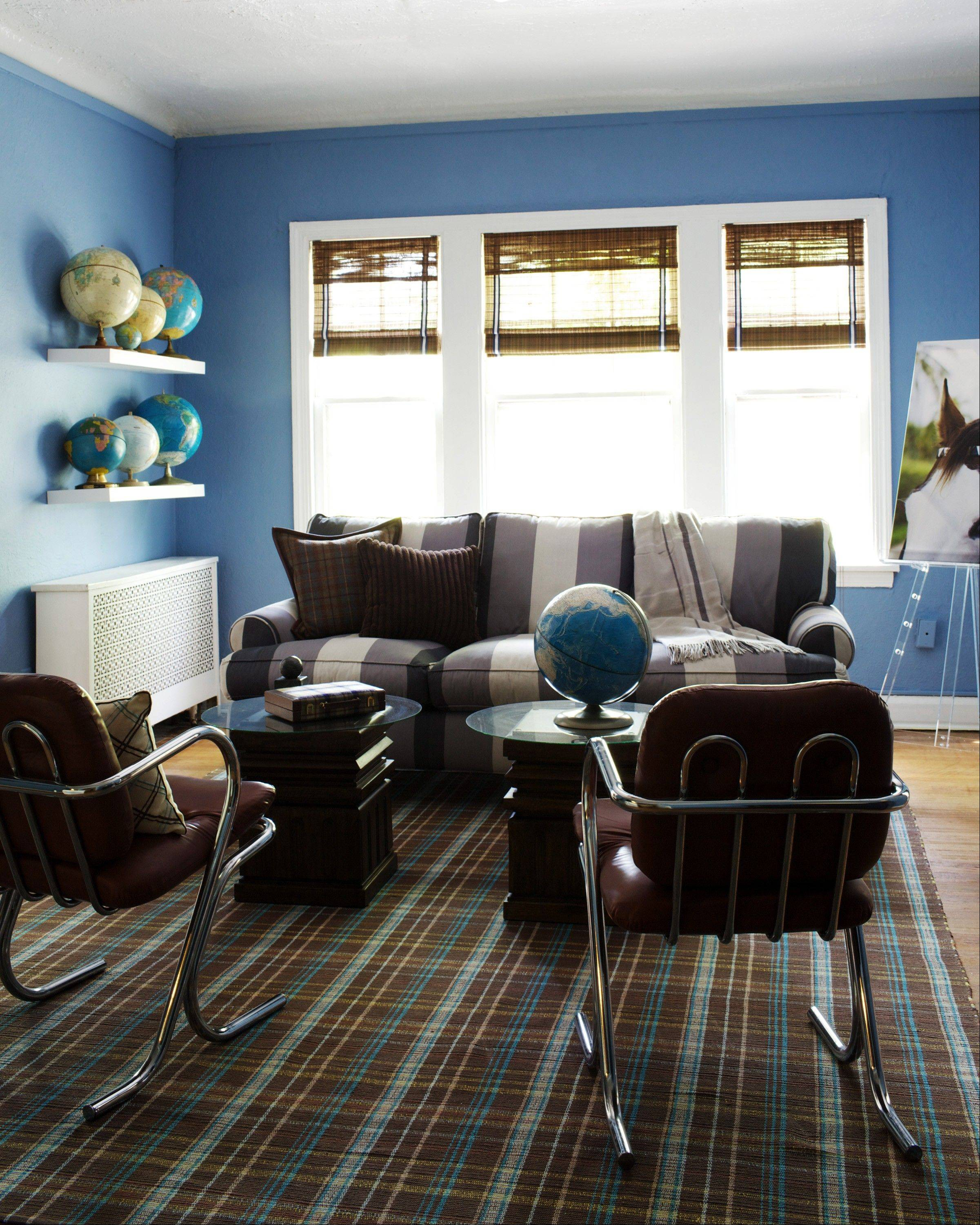 A bold sofa pattern and plaid carpet add personality to an apartment.