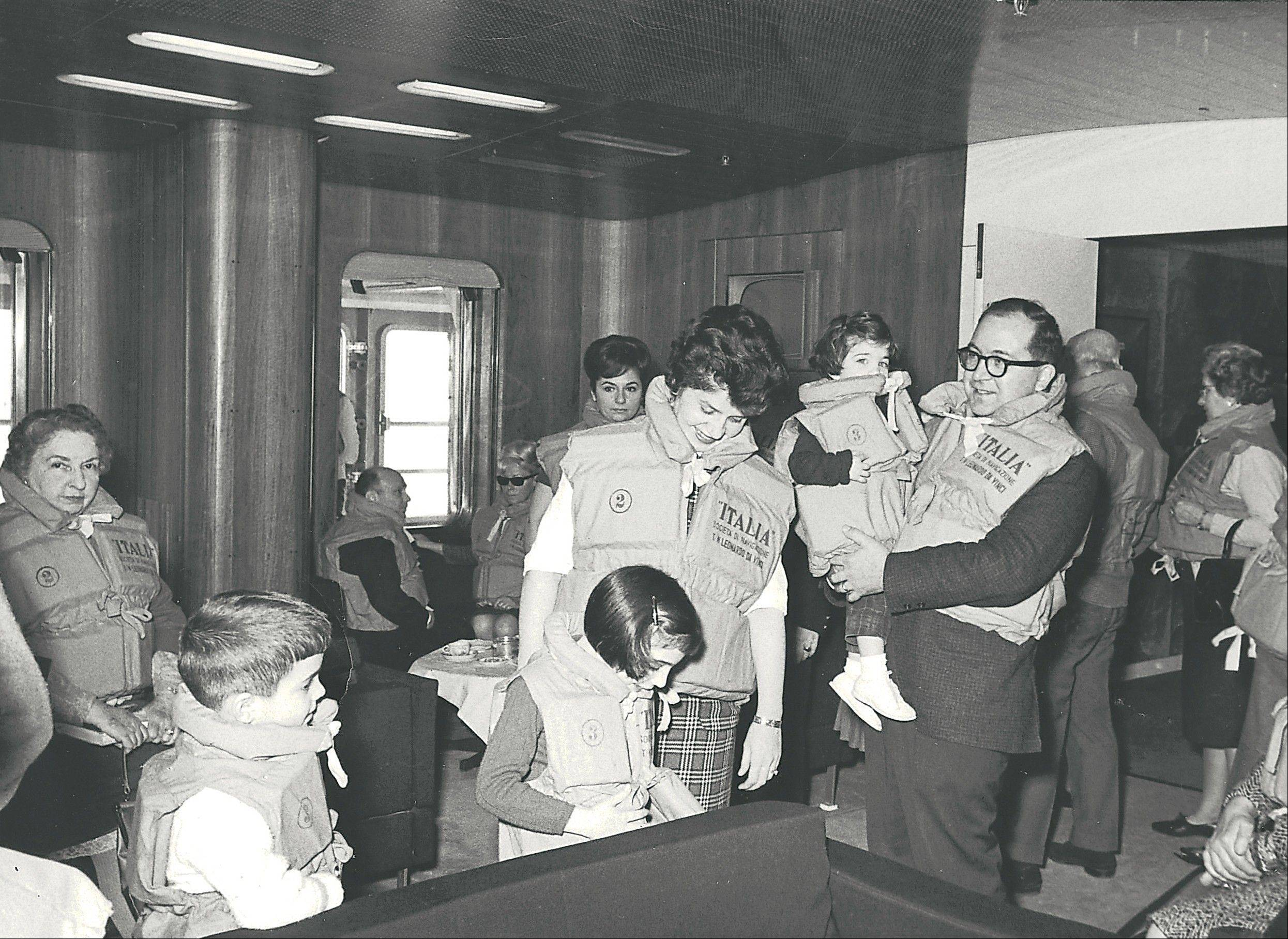 This 1965 photo shows Anne D�Innocenzio in the arms of her father, with her mother, sister and brother on a ship heading home from a family sojourn in Italy.